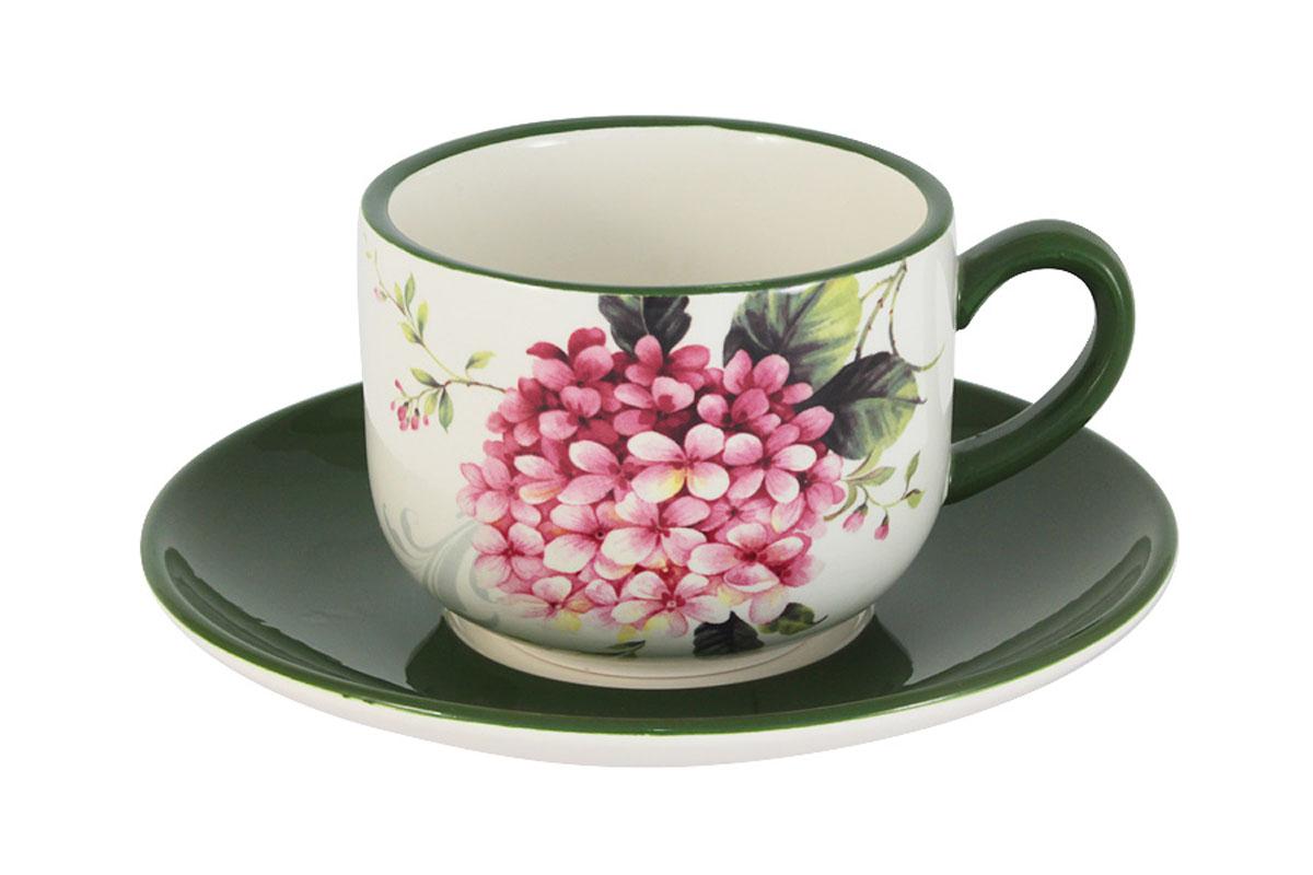 Чашка с блюдцем Infinity Цветы и птицыVT-1520(SR)Чашка с блюдцем Infinity Цветы и птицы изготовлены из высококачественной доломитовой керамики, отличительной особенностью которой являются легкость и белизна. Яркие декоры на такой керамике выглядят особенно привлекательно и ярко. Набор прекрасно подойдет для сервировки стола и станет незаменимым атрибутом чаепития. Чайная пара упакована в подарочную коробку, что позволит ей стать хорошим подарком. Не рекомендуется использовать в микроволновых печах. Мыть в теплой воде с применением мягких моющих средств. Не стоит часто мыть в посудомоечной машине, поскольку при постоянном мытье в ней рисунок может потерять свою яркость. Объем чашки: 250 мл.