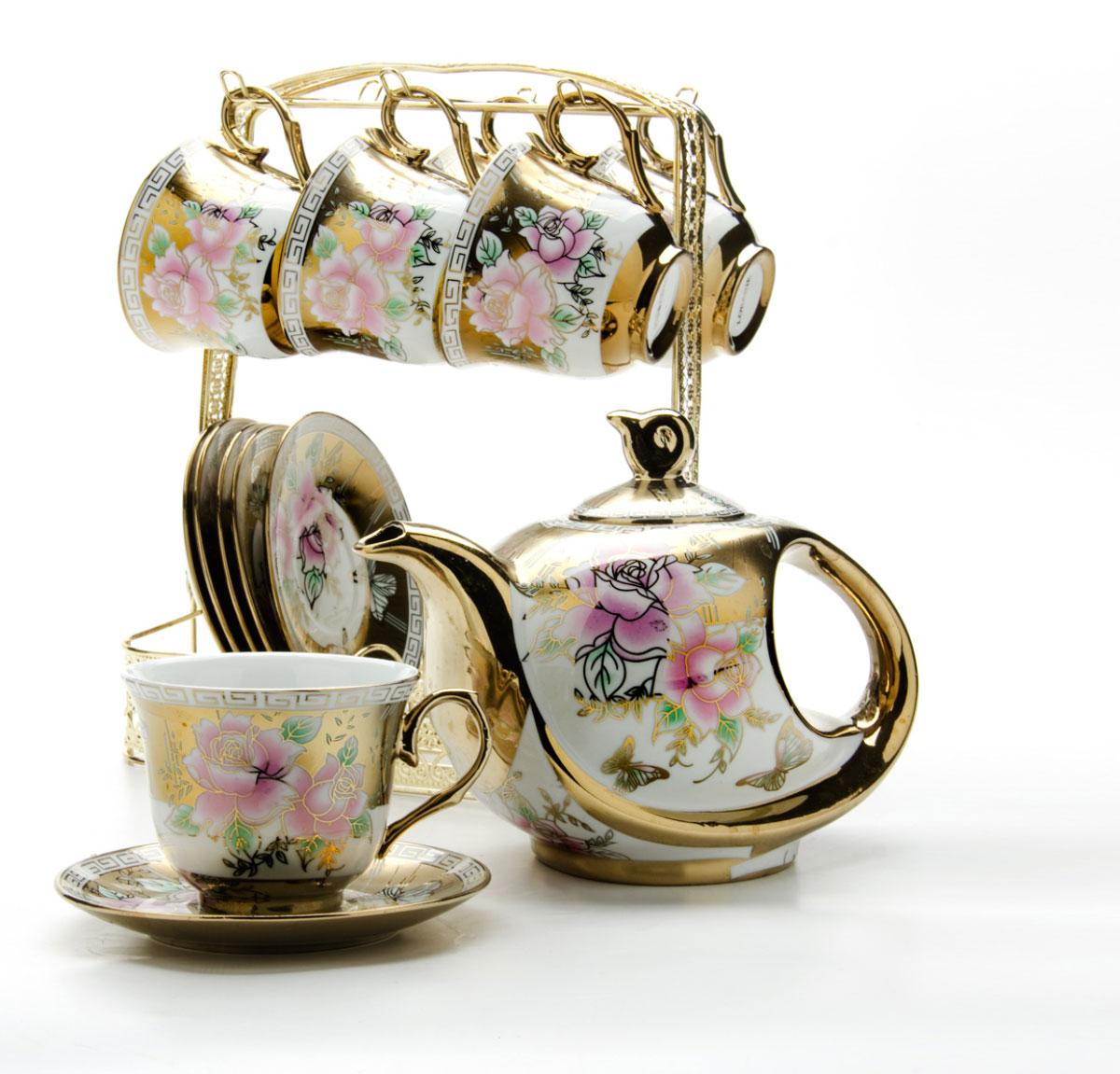 Набор чайный Loraine, на подставке, 15 предметов. 24785115610Чайный набор Loraine состоит из шести чашек, шести блюдец и заварочного чайника. Предметы набора изготовлены из керамики и оформлены изображением цветов и бабочек. Все предметы располагаются на удобной металлической подставке с ручкой. Элегантный дизайн набора придется по вкусу и ценителям классики, и тем, кто предпочитает утонченность и изысканность. Он настроит на позитивный лад и подарит хорошее настроение с самого утра. Чайный набор идеально подойдет для сервировки стола и станет отличным подарком к любому празднику.Объем чашки: 220 мл.Объем чайника: 950 мл.Диаметр блюдца: 13,5 см.