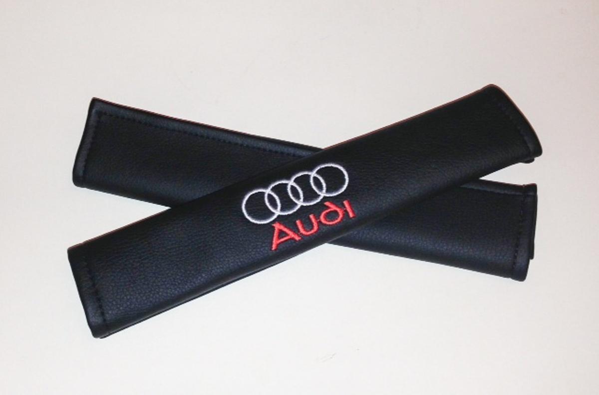 Накладки на ремень безопасности Auto Premium Audi, 2 штVT-1520(SR)Накладка Auto Premium Audi легко закрепляется на ремне безопасности и решает ряд назойливых проблем. Ремень больше не натрет плечо, благодаря тому, что изделие выполнено из мягкой экокожи и не мешает движению ремня. Накладка позволит защитить вашу одежду от следов ремня безопасности. В жаркую погоду в местах соприкосновения с ремнем кожа не будет потеть, так как накладка выполнена из дышащего материала.