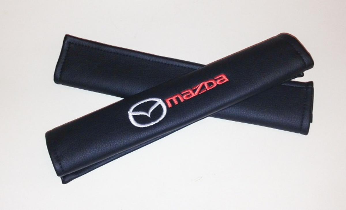 Накладки на ремень безопасности Auto Premium Mazda, 2 шт238000Накладка Auto Premium Mazda легко закрепляется на ремне безопасности и решает ряд назойливых проблем. Ремень больше не натрет плечо, благодаря тому, что изделие выполнено из мягкой экокожи и не мешает движению ремня. Накладка позволит защитить вашу одежду от следов ремня безопасности. В жаркую погоду в местах соприкосновения с ремнем кожа не будет потеть, так как накладка выполнена из дышащего материала.