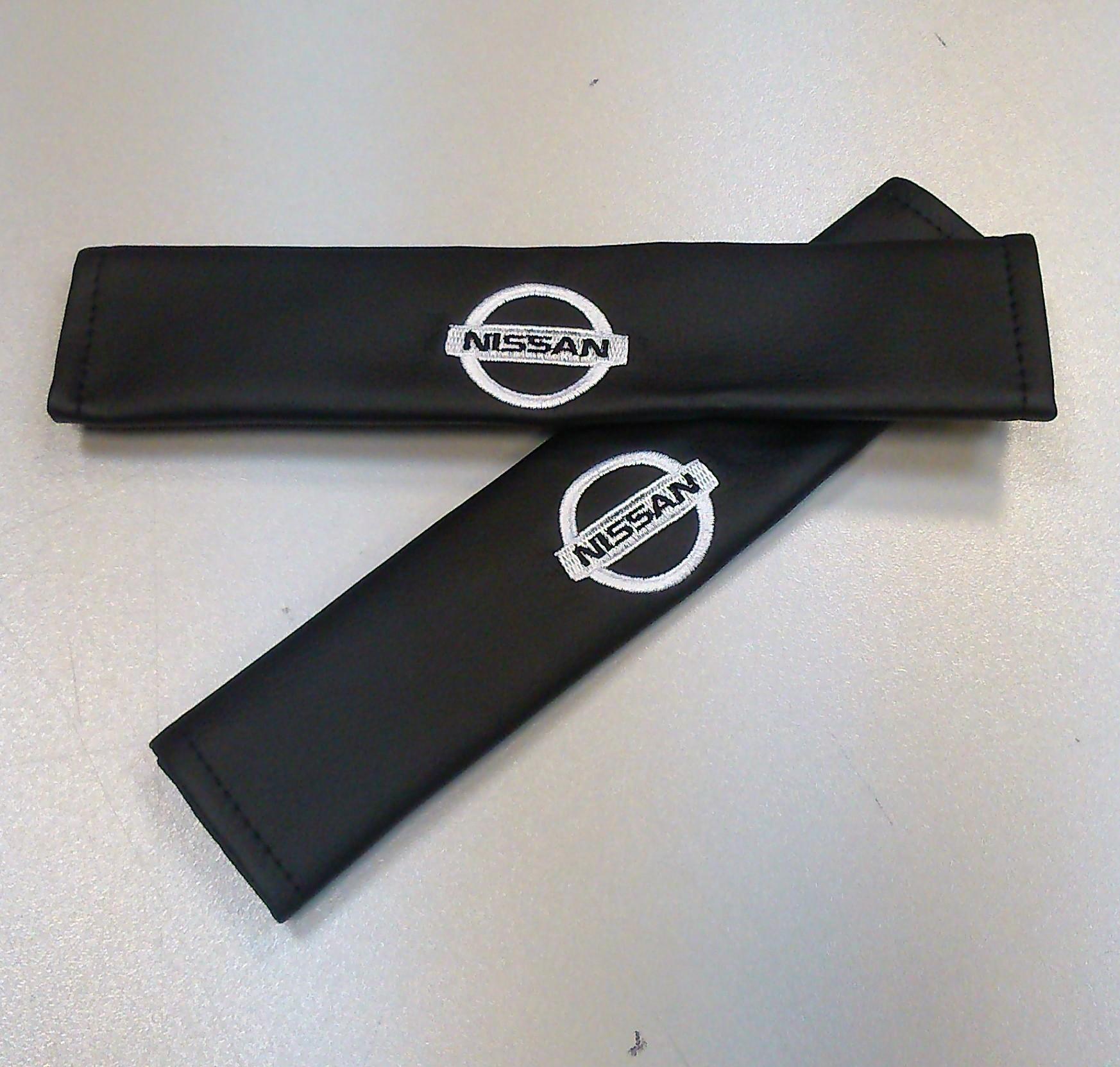 Накладки на ремень безопасности Auto Premium Nissan, 2 шт98298130Накладка Auto Premium Nissan легко закрепляется на ремне безопасности и решает ряд назойливых проблем. Ремень больше не натрет плечо, благодаря тому, что изделие выполнено из мягкой экокожи и не мешает движению ремня. Накладка позволит защитить вашу одежду от следов ремня безопасности. В жаркую погоду в местах соприкосновения с ремнем кожа не будет потеть, так как накладка выполнена из дышащего материала.
