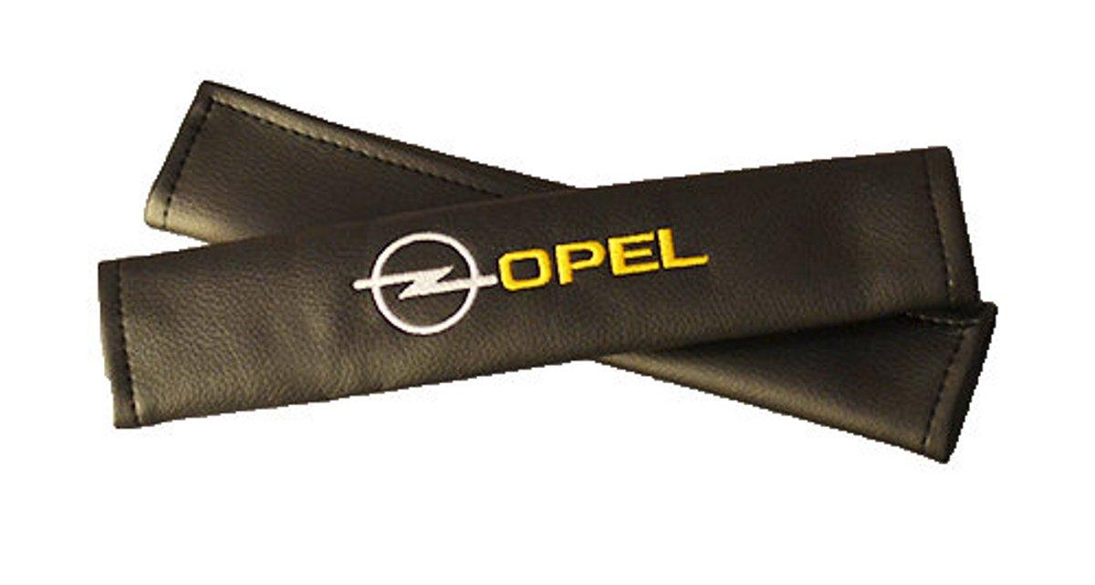 Накладки на ремень безопасности Auto Premium Opel, 2 шт98298130Накладка Auto Premium Opel легко закрепляется на ремне безопасности и решает ряд назойливых проблем. Ремень больше не натрет плечо, благодаря тому, что изделие выполнено из мягкой экокожи и не мешает движению ремня. Накладка позволит защитить вашу одежду от следов ремня безопасности. В жаркую погоду в местах соприкосновения с ремнем кожа не будет потеть, так как накладка выполнена из дышащего материала.
