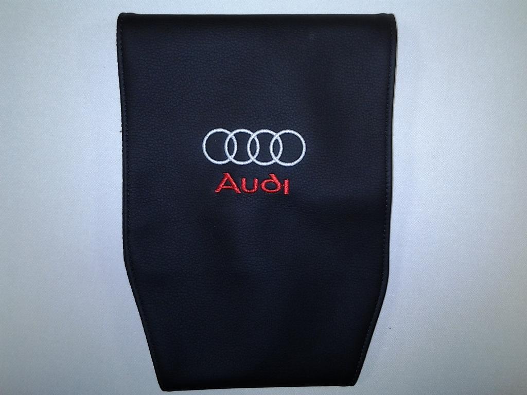 Чехол на подголовник Auto Premium Audi, 2 шт21395598Чехол Auto Premium Audi - это простая, эффектная и эффективная защита подголовника автомобиля. Накладка легко закрепляется вокруг подголовника и служит надежной защитой от загрязнения. Экокожа это износостойкий и долговечный материал. Такой чехол легко чистится влажной тряпкой.