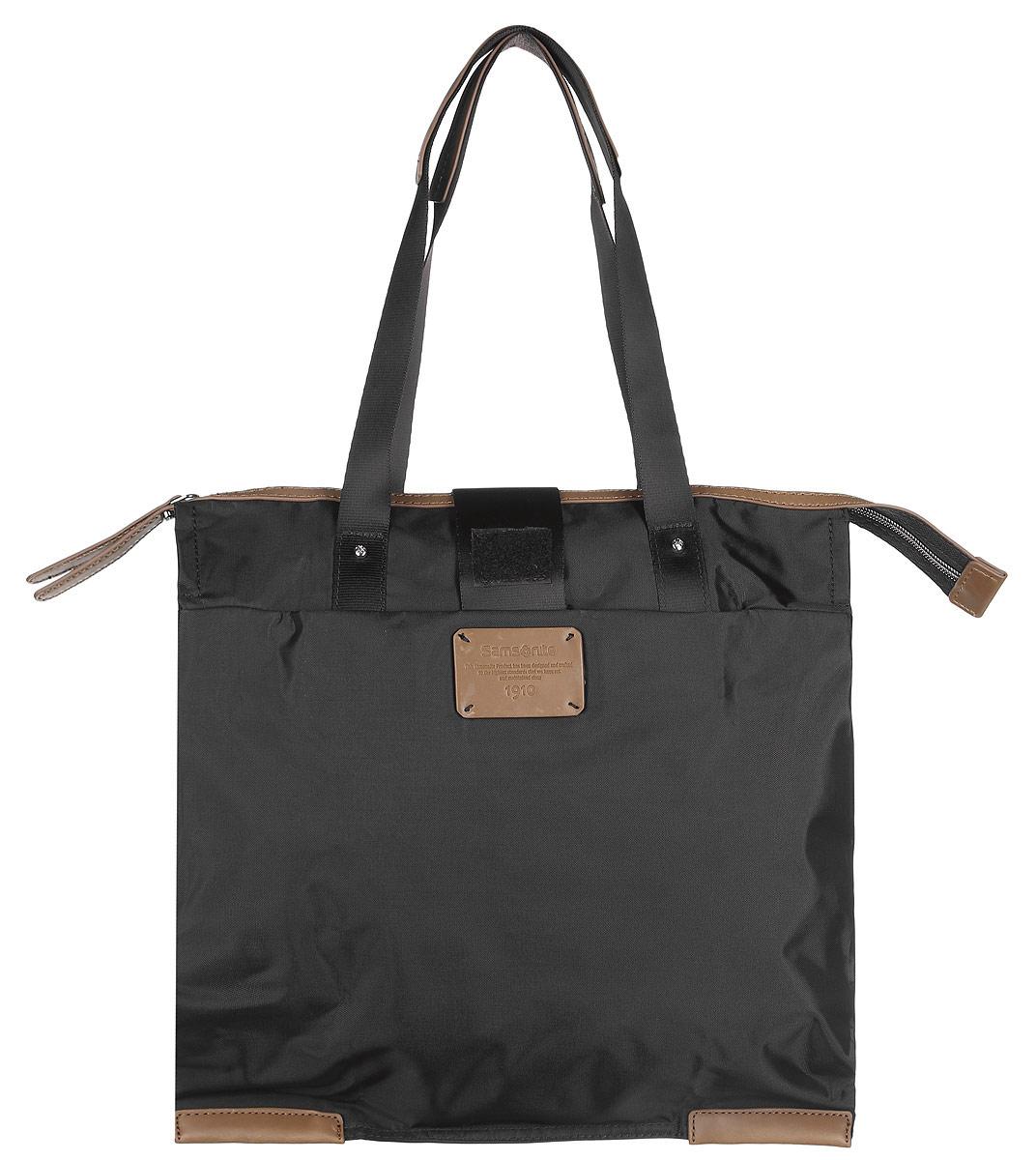 Сумка складная Samsonite, цвет: черный. 52V-090028-2Складная женская сумка Samsonite выполнена из полиамида с добавлением полиуретана и оформлена контрастными вставками и нашивкой логотипа бренда. Изделие содержит одно вместительное отделение, закрывающееся на застежку-молнию. На внешней стороне сумки есть прорезной открытый карман. Сумка оснащена двумя удобными ручками, высота которых позволяет носить сумку как в руке, так и на плече.Сумка не имеет жесткой структуры, за счет чего быстро складывается и фиксируется хлястиком с липучкой и не занимает много места. Такая сумка будет удобна в хранении и в использовании.