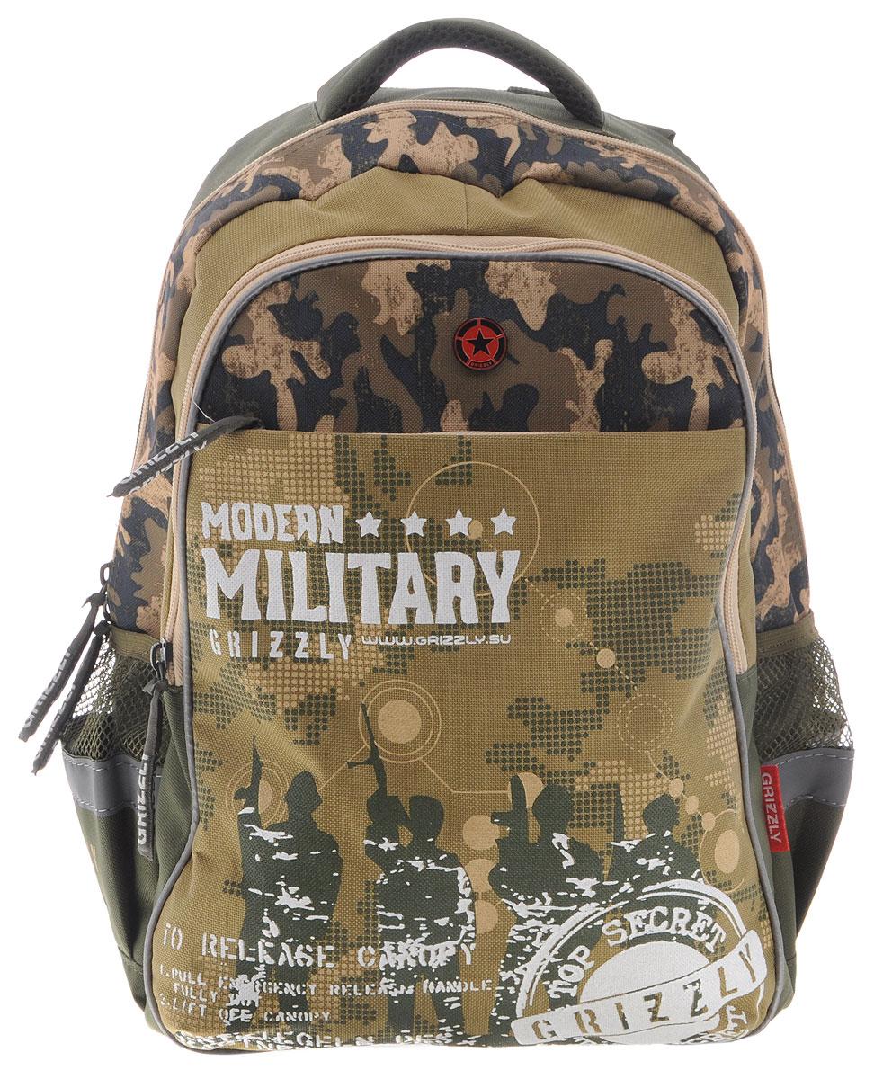 Grizzly Рюкзак детский Modern Military цвет хакиRB-632-2/3Школьный рюкзак Grizzly Modern Military - это стильный рюкзак, который подойдет всем, кто хочет разнообразить свои школьные будни. Выполнен из плотного полиэстера цвета хаки.Благодаря уплотненной спинке и двум мягким плечевым ремням, длина которых регулируется, у ребенка не возникнут проблемы с позвоночником. Конструкция спинки дополнена двумя эргономичными подушечками, противоскользящей сеточкой и системой вентиляции для предотвращения запотевания спины ребенка.Рюкзак состоит из двух основных вместительных отделений, закрывающихся на застежки-молнии. Большое основное отделение содержит небольшой карман на молнии. Лицевая сторона оснащена накладным карманом на застежке-молнии. По бокам рюкзака расположены два небольших сетчатых кармана.Для удобной переноски предусмотрена текстильная ручка.Такой школьный рюкзак станет незаменимым спутником вашего ребенка в походах за знаниями.