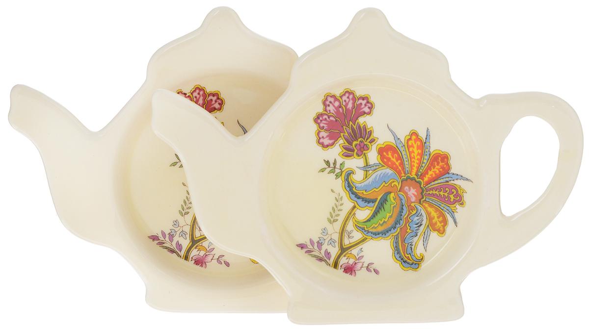 Подставка для чайных пакетиков Loraine, 12,4 х 9 см, 2 штFS-91909Подставка Loraine, изготовленная из прочной керамики высокого качества, порадует вас оригинальностью и дизайном. Подставка выполнена в форме чайника с изображением цветов. С помощью такой подставки для чайных пакетиков ваша столешница останется чистой. Длина подставки: 12,4 х 9 см.Ширина подставки: 1,5 см.