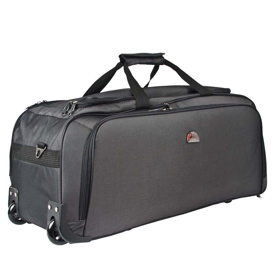 Сумка дорожная Polar, на колесах, цвет: черный, 72 л. 7022.5FABLSEH10002Дорожная сумка Polar выполнена из высокопрочного материала кордура. Сумка имеет одно большое отделение и карман для мелких вещей. В комплект входит съемный плечевой ремень. Очень удобный и практичный вариант для всего самого необходимого. Сумка оснащена 2 пластиковыми колесами и выдвижной ручкой.
