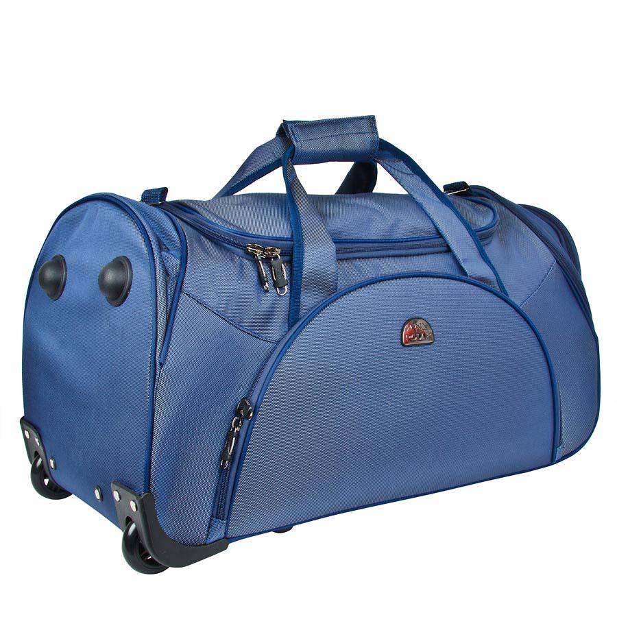 Сумка дорожная на колесах Polar, 75 л, цвет: синий. 7037.5L32862900Вместительная дорожная сумка среднего размера фирмы Polar. Материал – кордура. Пластиковые колеса (2 шт.), выдвижная ручка (при горизонтальной транспортировке, ручка прячется под специальный клапан на молнии), внутренняя тележка. Большое отделение с дополнительным карманом на молнии из сетка внутри. На передней части сумки вместительный карман с дополнительным карманом на молнии внутри и два боковых кармана для мелких вещей. В комплект входит съемный плечевой ремень.