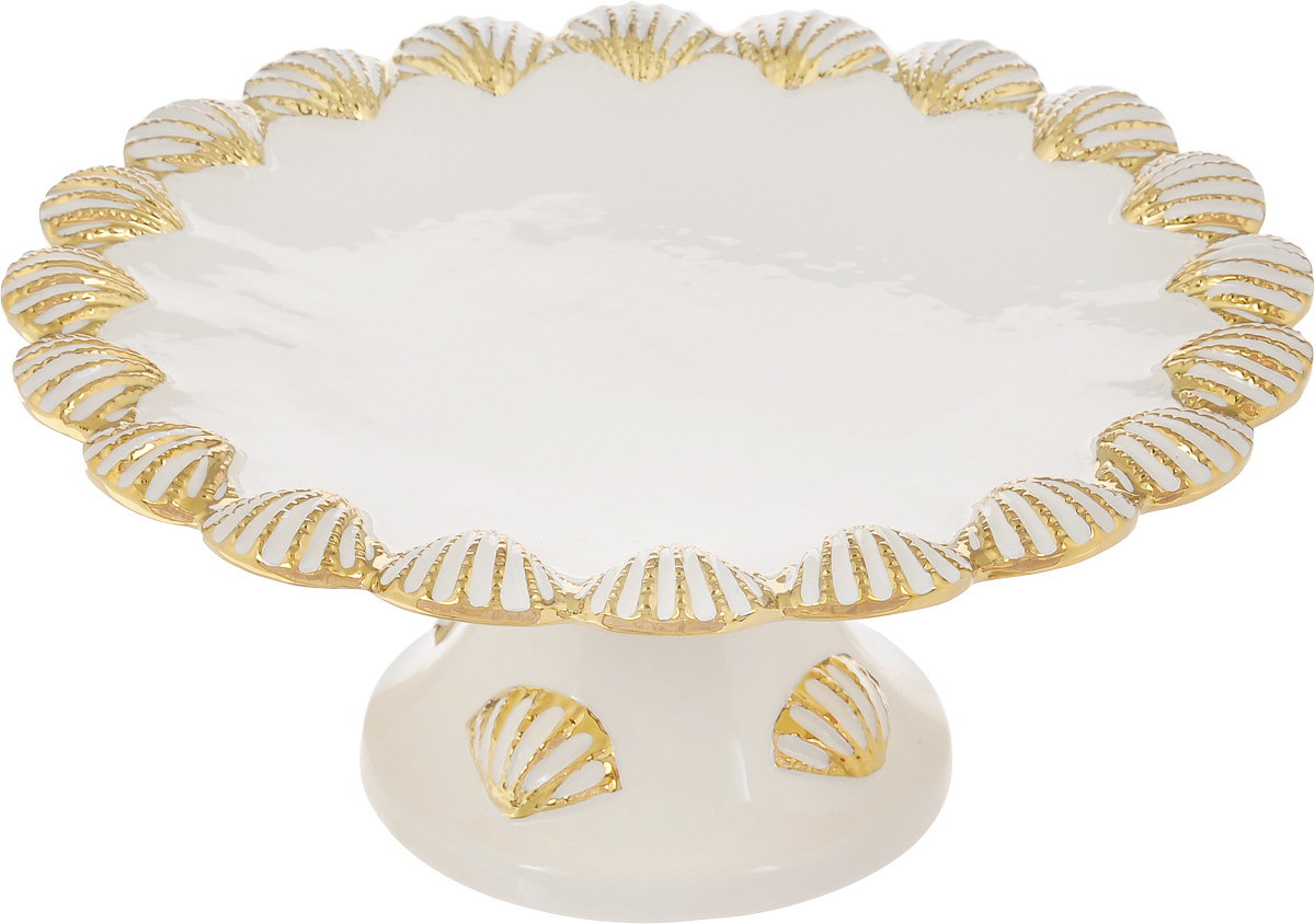 Блюдо для торта Patricia Ракушка, диаметр 28 см115510Блюдо для торта Patricia Ракушка выполнено из доломита с рельефной поверхностью. Посуда обладает гладкой непористой поверхностью и не впитывает запахи, ее легко и просто мыть. Изящный дизайн и красочность оформления придутся по вкусу и ценителям классики, и тем, кто предпочитает утонченность и изысканность.Не рекомендуется мыть в посудомоечной машине и использовать в микроволновой печи.Диаметр блюда: 28 см.