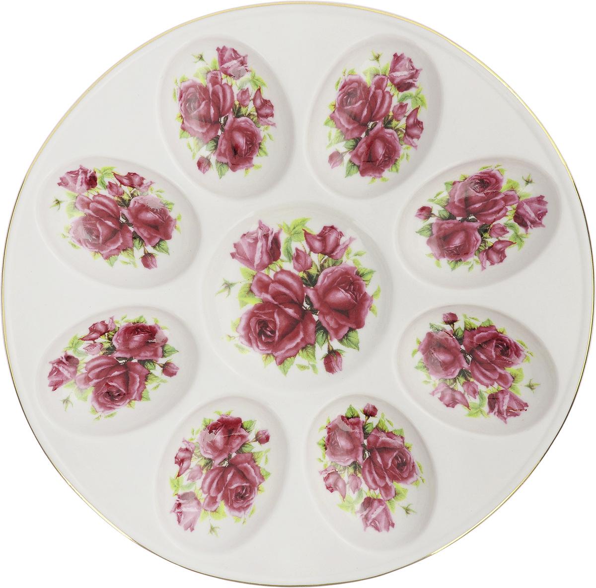 Тарелка для фаршированных яиц Patricia Розы, диаметр 20 смVT-1520(SR)Тарелка для фаршированных яиц Patricia Розы, изготовленная из высококачественного фарфора, украсит ваш праздничный или обеденной стол. На изделии имеются специальные углубления для 8 яиц, а также 1 углубление для соуса, соли или специй. Изделие оформлено ярким изображением цветов и декорировано золотистой каймой.Такая тарелка украсит сервировку вашего стола и подчеркнет прекрасный вкус хозяйки. Диаметр тарелки (по верхнему краю): 20 см.