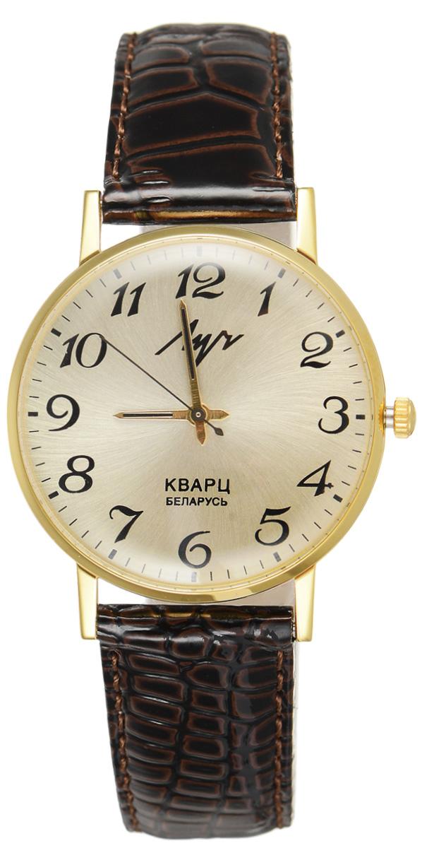 Часы наручные мужские Луч, цвет: темно-коричневый, золотистый. 31618732BM8434-58AEМодные мужские часы Луч из коллекции Ретро выполнены из силикатного стекла, натуральной кожи и металла с покрытием из комбинированного твердого золота. Циферблат оформлен символикой бренда.Корпус часов оснащен кварцевым механизмом со сменным элементом питания, а также дополнен ремешком из натуральной кожи, который застегивается на пряжку. Ремешок декорирован тиснением под кожу рептилии. Часы поставляются в фирменной упаковке.Часы Луч - стильный аксессуар, выгодно дополняющий любой образ.
