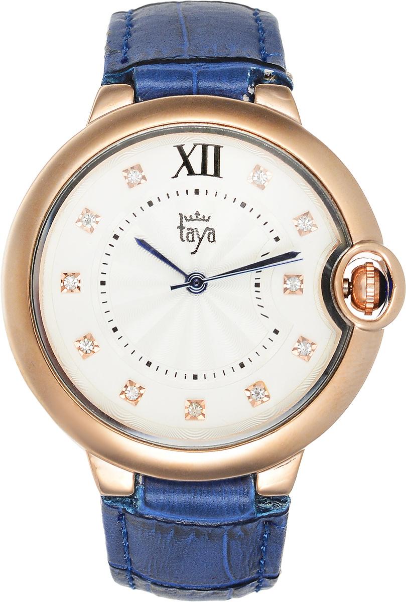 Часы наручные женские Taya, цвет: золотистый, синий. T-W-0002BM8434-58AEЭлегантные женские часы Taya выполнены из минерального стекла, натуральной кожи и нержавеющей стали. Циферблат инкрустирован стразами и дополнен символикой бренда.Корпус часов оснащен кварцевым механизмом со сменным элементом питания, а также дополнен ремешком из натуральной кожи, который застегивается на пряжку. Ремешок декорирован тиснением под кожу рептилии.Часы поставляются в фирменной упаковке.Часы Taya подчеркнут изящность женской руки и отменное чувство стиля у их обладательницы.