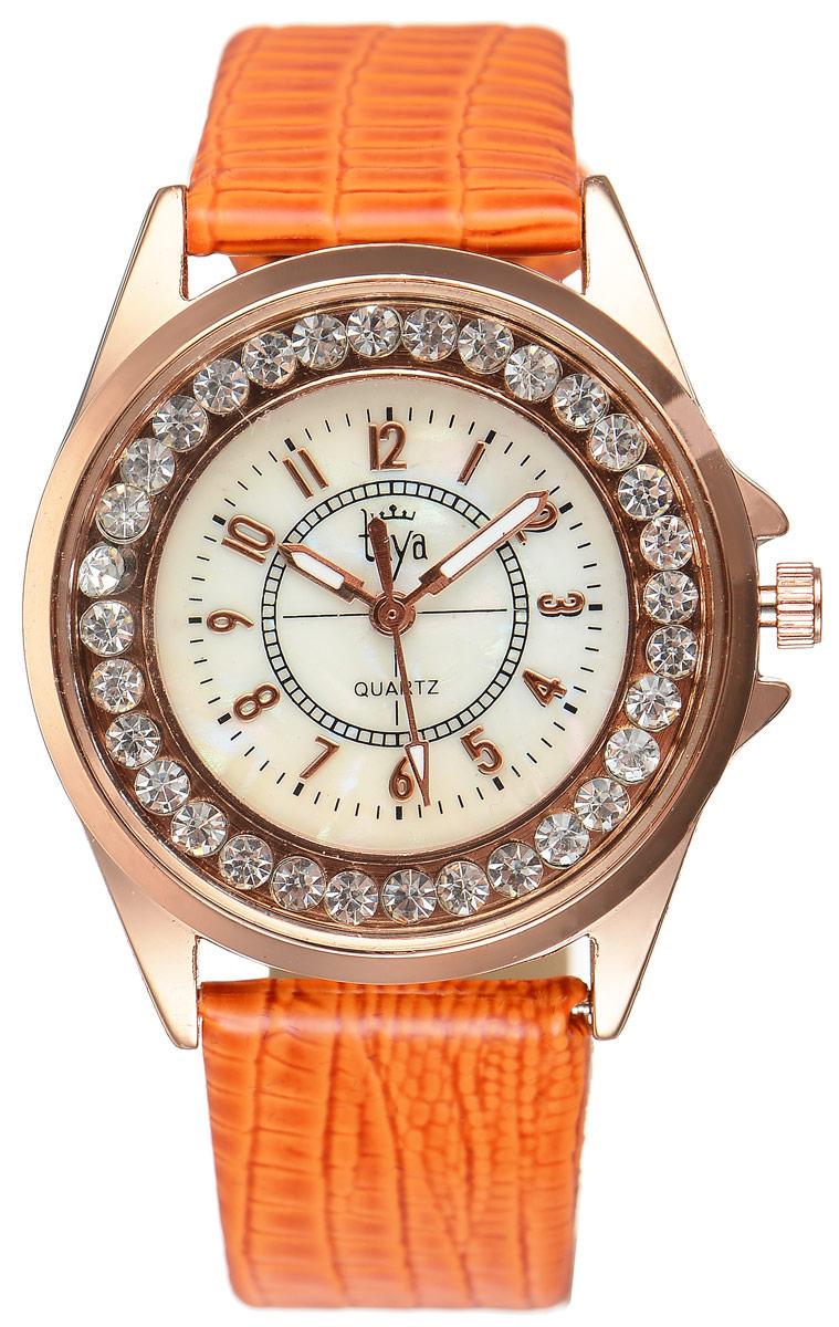 Часы наручные женские Taya, цвет: золотистый, оранжевый. T-W-0038BM8434-58AEЭлегантные женские часы Taya выполнены из минерального стекла, искусственной кожи и нержавеющей стали. Корпус часов украшен стразами, циферблат оформлен перламутром и символикой бренда.Корпус часов оснащен кварцевым механизмом со сменным элементом питания, а также дополнен ремешком из искусственной кожи, который застегивается на пряжку. Ремешок декорирован тиснением под кожу рептилии.Часы поставляются в фирменной упаковке.Часы Taya подчеркнут изящность женской руки и отменное чувство стиля у их обладательницы.