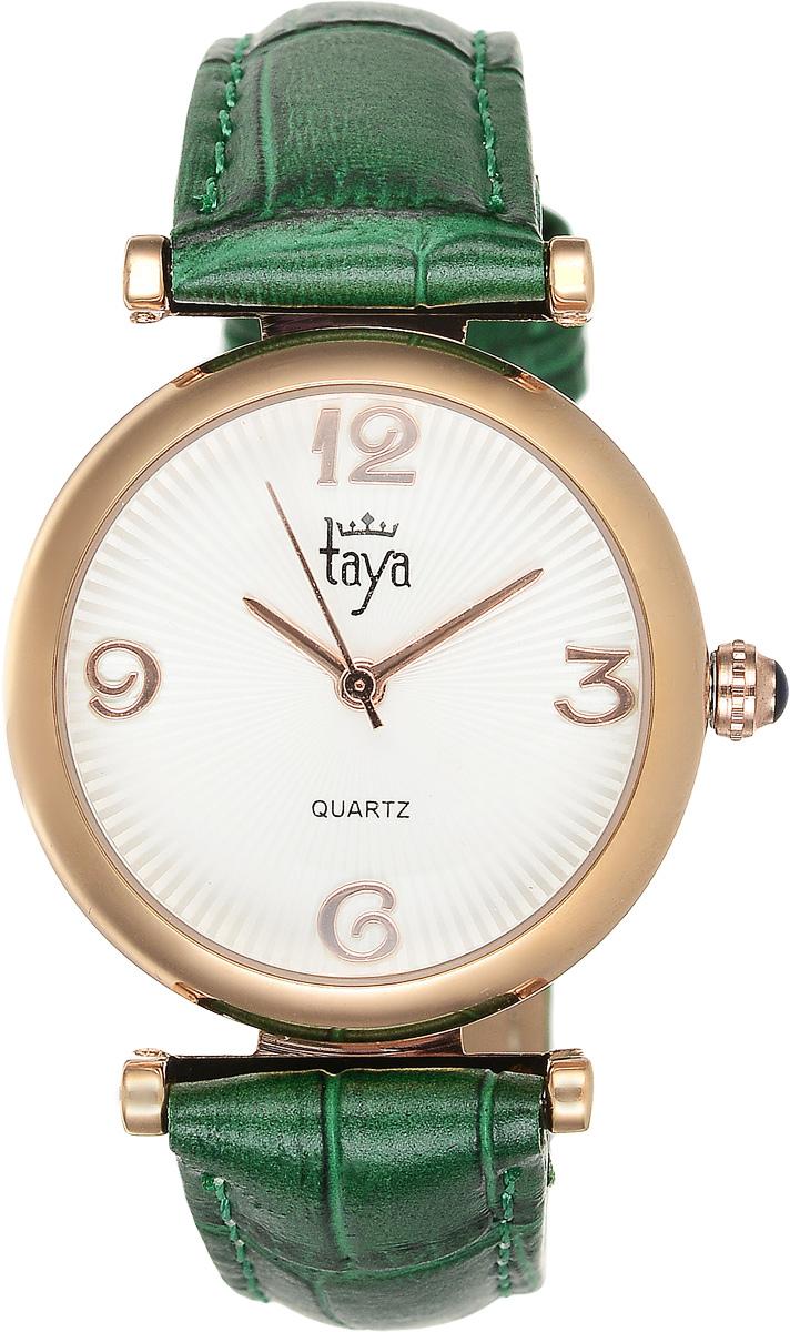 Часы наручные женские Taya, цвет: золотистый, зеленый. T-W-0013BM8434-58AEЭлегантные женские часы Taya выполнены из минерального стекла, натуральной кожи и нержавеющей стали. Циферблат часов украшен символикой бренда.Корпус часов оснащен кварцевым механизмом со сменным элементом питания, а также дополнен ремешком из натуральной кожи, который застегивается на пряжку. Кожаный ремешок декорирован тиснением под кожу рептилии.Часы поставляются в фирменной упаковке.Часы Taya подчеркнут изящность женской руки и отменное чувство стиля у их обладательницы.