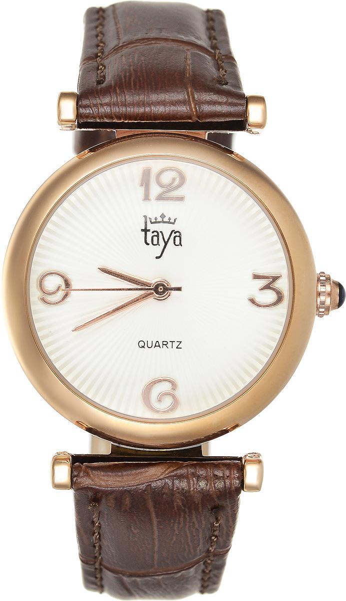 Часы наручные женские Taya, цвет: золотистый, коричневый. T-W-0015BM8434-58AEЭлегантные женские часы Taya выполнены из минерального стекла, натуральной кожи и нержавеющей стали. Циферблат часов украшен символикой бренда.Корпус часов оснащен кварцевым механизмом со сменным элементом питания, а также дополнен ремешком из натуральной кожи, который застегивается на пряжку. Кожаный ремешок декорирован тиснением под кожу рептилии.Часы поставляются в фирменной упаковке.Часы Taya подчеркнут изящность женской руки и отменное чувство стиля у их обладательницы.