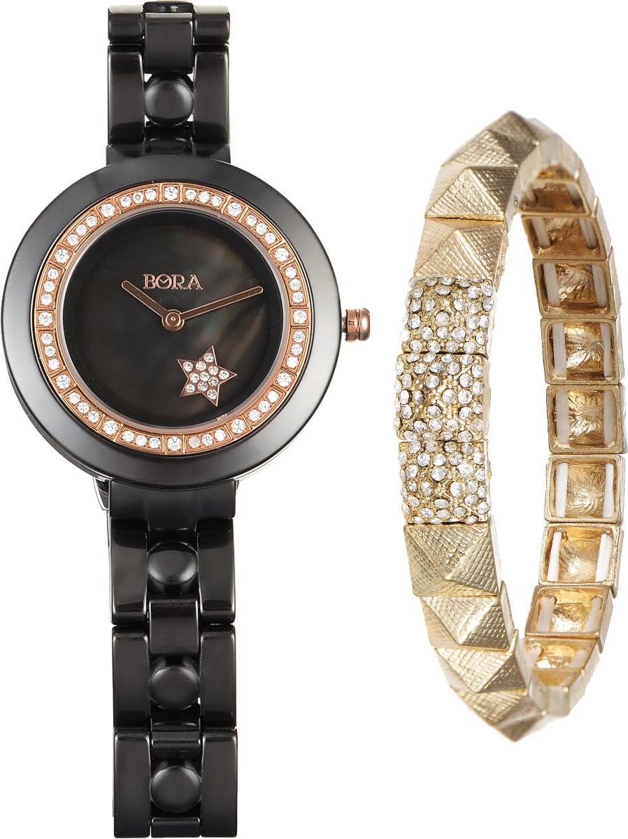 Часы наручные женские Bora, с браслетом, цвет: черный, золотой. T-B-6715BM8434-58AEЭлегантные женские часы Bora выполнены из керамики и минерального стекла. Корпус часов украшен стразами. Перламутровый циферблат дополнен символикой бренда и оформлен декоративным элементом в виде звезды, которая инкрустирована стразами.Корпус часов оснащен кварцевым механизмом со сменным элементом питания, а также дополнен браслетом, который застегивается на застежку-бабочку.Стильный браслет выполнен из бижутерийного сплава и декорирован тремя элементами, инкрустированными стразами и эффектно дополняющими украшение. Благодаря эластичной основе браслет идеально разместится на запястье.Часы и браслет поставляются в фирменной упаковке.Часы Bora с браслетом подчеркнут изящность женской руки и отменное чувство стиля у их обладательницы.