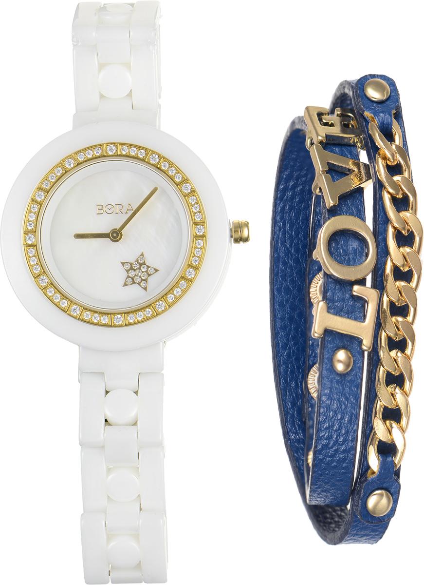 Часы наручные женские Bora, с браслетом, цвет: белый, золотой, синий. T-B-6712BM8434-58AEЭлегантные женские часы Bora выполнены из керамики и минерального стекла. Корпус часов также украшен стразами. Перламутровый циферблат дополнен символикой бренда и оформлен декоративным элементом в виде звезды, которая инкрустирована стразами.Корпус часов оснащен кварцевым механизмом со сменным элементом питания, а также дополнен браслетом, который застегивается на металлическую застежку-бабочку.Стильный браслет выполнен из искусственной кожи с декоративными элементами из бижутерийного сплава. Эффектно дополняет украшение надпись Love, выполненная из подвижных элементов. Украшение застегивается на кнопку.Часы и браслет поставляются в фирменной упаковке.Часы Bora с браслетом подчеркнут изящность женской руки и отменное чувство стиля у их обладательницы.