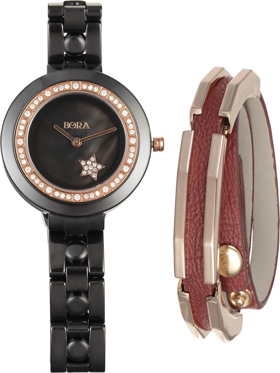 Часы наручные женские Bora, с браслетом, цвет: черный, золотой, бордовый. T-B-9642BM8434-58AEЭлегантные женские часы Bora выполнены из керамики и минерального стекла. Корпус часов украшен стразами. Перламутровый циферблат дополнен символикой бренда и оформлен декоративным элементом в виде звезды, которая инкрустирована стразами.Корпус часов оснащен кварцевым механизмом со сменным элементом питания, а также дополнен браслетом, который застегивается на застежку-бабочку.Стильный браслет выполнен из искусственной кожи с декоративными элементами из бижутерийного сплава. Украшение застегивается на кнопку, длина регулируется.Часы и браслет поставляются в фирменной упаковке.Часы Bora с браслетом подчеркнут изящность женской руки и отменное чувство стиля у их обладательницы.