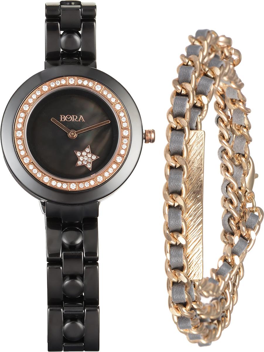 Часы наручные женские Bora с браслетом, цвет: черный, золотой. T-B-6714BM8434-58AEЭлегантные женские часы Bora выполнены из керамики и минерального стекла. Корпус часов украшен стразами. Перламутровый циферблат дополнен символикой бренда и оформлен декоративным элементом в виде звезды, которая инкрустирована стразами.Корпус часов оснащен кварцевым механизмом со сменным элементом питания, а также дополнен браслетом, который застегивается на застежку-бабочку.Стильный браслет выполнен из бижутерийного сплава и искусственной кожи, оформлен прямоугольной пластиной с рельефной гравировкой. Украшение застегивается на практичный замок-карабин.Часы и браслет поставляются в фирменной упаковке.Часы Bora с браслетом подчеркнут изящность женской руки и отменное чувство стиля у их обладательницы.