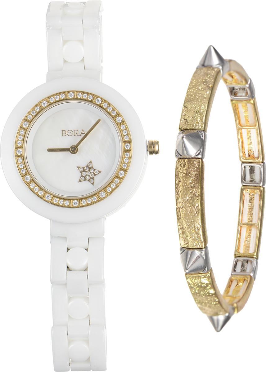 Часы наручные женские Bora, с браслетом, цвет: белый, золотой. T-B-6711BM8434-58AEЭлегантные женские часы Bora выполнены из керамики и минерального стекла. Корпус часов украшен стразами. Перламутровый циферблат дополнен символикой бренда и оформлен декоративным элементом в виде звезды, которая инкрустирована стразами.Корпус часов оснащен кварцевым механизмом со сменным элементом питания, а также дополнен браслетом, который застегивается на застежку-бабочку.Стильный браслет выполнен из бижутерийного сплава. Декоративные элементы в форме шипов эффектно дополняют украшение. Благодаря эластичной основе браслет идеально разместится на запястье.Часы и браслет поставляются в фирменной упаковке.Часы Bora с браслетом подчеркнут изящность женской руки и отменное чувство стиля у их обладательницы.