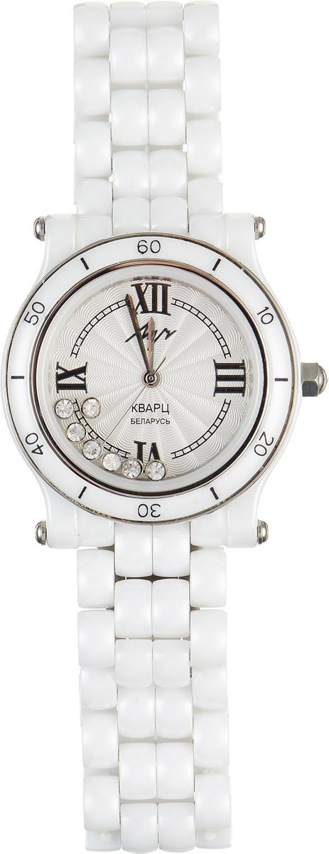 Часы наручные женские Луч, цвет: белый. 928637184BM8434-58AEМодные женские часы Луч из Керамической коллекции подчеркнут изящность женской руки и отменное чувство стиля у их обладательницы.Часы выполнены из керамики, нержавеющей стали и минерального стекла. Циферблат, украшенный символикой бренда, дополнен двумя стеклами, между которыми свободно перемещаются стразы.Корпус часов оснащен кварцевым механизмом со сменным элементом питания, а также дополнен браслетом, который застегивается на застежку-бабочку.Часы поставляются в фирменной упаковке.