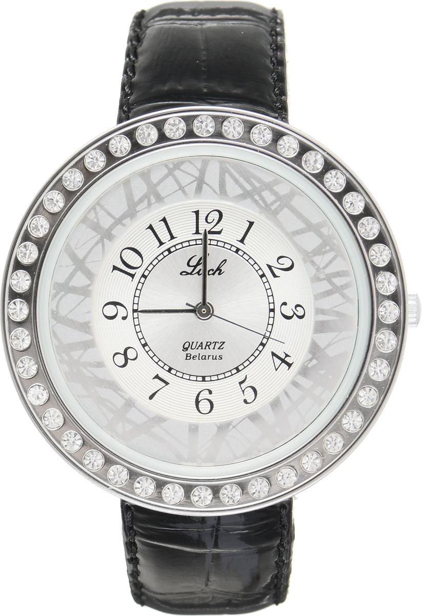 Часы наручные женские Луч, цвет: серебряный, черный. 35401342BM8434-58AEЭлегантные женские часы Луч выполнены из металлического сплава и силикатного стекла. Корпус с покрытием из хрома обладает высокой стойкостью к стиранию. Корпус часов инкрустирован стразами. Циферблат оформлен символикой бренда.Часы оснащены кварцевым механизмом со сменным элементом питания, а также дополнены ремешком из натуральной кожи с лаковым покрытием и декоративным тиснением, который застегивается на практичную пряжку.Часы Луч подчеркнут изящность женской руки и отменное чувство стиля их обладательницы.