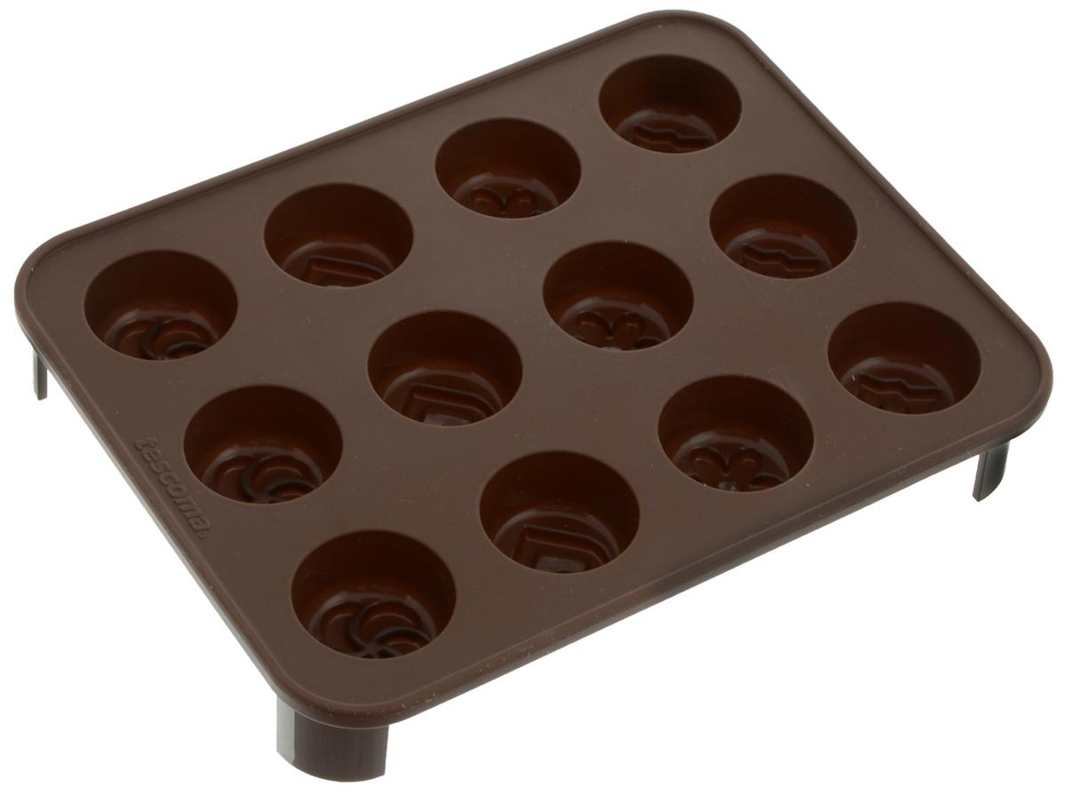 Формочка для шоколада Tescoma Delicia Choco. Шокомикс, с подставкой, 12 ячеек68/5/4Формочка для шоколада Tescoma Delicia Choco. Шокомикс отлично подходит для приготовления шоколадных конфет, шоколадных трюфелей, ароматных кокосок, молочных ирисок и кубиков для льда, а также печенья. Формочка выполнена из высококачественного эластичного термоустойчивого силикона, выдерживающего температуру от -40°С до +230°С. Готовый шоколад не липнет и легко вынимается. Форма имеет 12 круглых ячеек с рельефом в виде сердечка, цветка, звезды и вертушки. Форма поставляется с пластиковой подставкой для хорошей устойчивости. В комплекте - буклет с рецептами. Подходит для микроволновой печи или обычной печи, холодильника, морозильной камеры. Можно мыть в посудомоечной машине.Размер формочки: 18,5 х 14,5 х 2,5 см. Диаметр ячейки: 3,1 см.