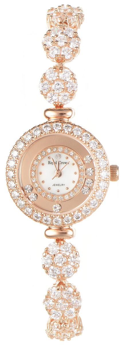 Часы наручные женские Royal Crown, цвет: золотой. 5308-B21-RSG-5BM8434-58AEИзысканные женские часы Royal Crown изготовлены из высокотехнологичной гипоаллергенной нержавеющей стали и латуни. Покрытие корпуса и браслета - палладий с розовым золотом и родием, что придает часам благородный блеск драгоценных металлов. Кварцевый механизм имеет степень влагозащиты равную 3 Bar и дополнен часовой, минутной и секундной стрелками. Корпус часов украшен двумя ободками из цирконов и декорирован россыпью камней, перемещающихся при движении руки. Браслет выполнен из соединяющихся между собой элементов, инкрустированных цирконами. Для того чтобы защитить циферблат от повреждений в часах используется высокопрочное минеральное стекло.На белом циферблате отметки в виде точек органично сочетаются с маленькими стрелками.Браслет комплектуется надежным и удобным в использовании складным замком, который позволит с легкостью снимать и надевать часы.Часы упакованы в фирменную коробку и дополнительно в подарочную сумку с названием бренда.Часы Royal Crown подчеркнут изящность женской руки и отменное чувство стиля у их обладательницы.