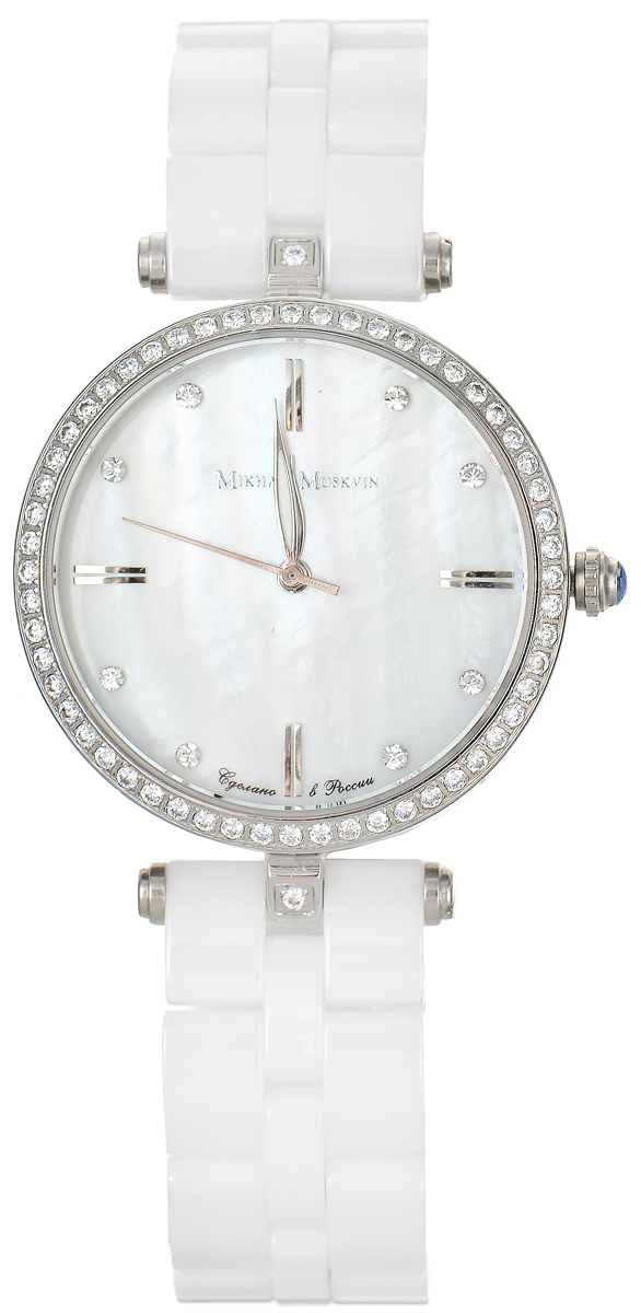 Часы наручные женские Mikhail Moskvin Elegance, цвет: белый, серебряный. 1195S16B1BM8434-58AEСтильные женские наручные часы Mikhail Moskvin из серии Elegance изготовлены из высокотехнологичной гипоаллергенной нержавеющей стали и дополнены изящным керамическим браслетом. Для того чтобы защитить циферблат от повреждений в часах используется высокопрочное стекло с сапфировым напылением. Тонкий ободок из сверкающих стразов обрамляет перламутровый циферблат. На перламутровой поверхности на месте индикации часов чередуются прямоугольные двойные знаки и круглые вставки - цирконы. Высокоточный японский кварцевый механизм производства фирмы Miyota Sitizen оснащен часовой, минутной и секундной стрелками. Стальные заостренные стрелки заполнены белой массой. Граненая заводная головка венчается блестящей сферой. Циферблат изделия оформлен символикой бренда.Браслет часов застегивается на замок-бабочку, который позволит с легкостью снимать и надевать часы.Часы упакованы в фирменную коробку с прозрачным окошком и дополнительно в текстильную сумку с названием бренда.Часы Mikhail Moskvin подчеркнут характер и отменное чувство стиля их обладательницы.