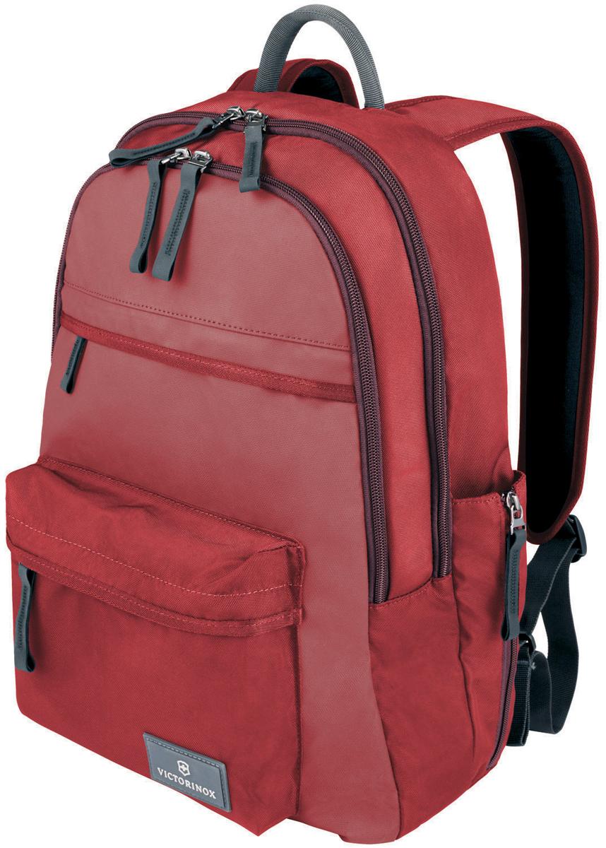 Рюкзак Victorinox Altmont 3.0. Standard Backpack, 20 л, цвет: красный. 32388403 + ПОДАРОК: нож-брелок Escort32388403Оригинальный швейцарский армейский нож Swiss Army был создан в 1897 году в небольшой деревушке Ибах в Швейцарии. С тех пор продукция, выпускаемая под маркой Victorinox с ее узнаваемым логотипом в виде креста на щите, по праву считается эталоном отличного качества, высокой функциональности, инновационных технологий и культового дизайна. Преданность принципам в течение последних 130 лет позволила создавать продукты, которые являются выдающимися не только по дизайну и качеству, но которые также являются надежными спутниками в больших и маленьких жизненных приключениях. Сегодня фирма с гордостью представляет линейку сумок, чемоданов и дорожных аксессуаров, которые наилучшим образом воплощают в себе данные принципы, а также сочетают в себе черты лучшего классического стиля. Индивидуальность - это то, что отличает вас от любого другого человека, с которым вы сталкиваетесь на улице, в поезде, с которым вы общаетесь в городе. Каждый день вашей жизни — это уникальный опыт, который никогда больше не повторится. Коллекция Altmont 3.0 создавалась с расчетом на индивидуальность. Неважно носите ли вы рюкзак, сумку-мессенджер или повседневную сумку — в коллекции Altmont 3.0 есть богатый выбор аксессуаров такой же многогранный, как и ваш индивидуальный стиль. Для вас просто не существуют такой вещи как обычный день, и также как и вы, наша коллекция справится с любой ситуацией. Прототип модели прошел целых 30 основательных и строгих испытаний, в ходе которых проводилась симуляция самых экстремальных сценариев и условий внешней среды, возможных в реальной жизни. Жесткий режим проводимых тестов гарантирует точность, прочность и износоустойчивость, т. е. все признаки высокого качества и эксплуатационных характеристик, которые покупатель ожидает от продукции Victorinox. Далее каждое изделие проходит тщательный контроль сертифицированным техническим специалистом. Характерис