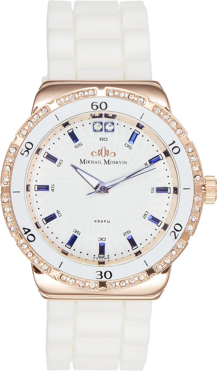 Часы наручные женские Mikhail Moskvin Каприз, цвет: белый, золотой. 589-8-4BM8434-58AEСтильные женские наручные часы Mikhail Moskvin Каприз изготовлены из высокотехнологичной гипоаллергенной нержавеющей стали и дополнены гибким элегантным ремешком из силикона, который мягко облегает запястье. Для того чтобы защитить циферблат от повреждений в часах используется высокопрочное минеральное стекло.Часовая, минутная и секундная стрелки приходят в движение благодаря надежному кварцевому механизму. В модели используются японские механизмы Epson и Miyota.Корпус традиционной круглой формы, покрыт золотым IPG-покрытием и дополнен черной минутной шкалой в виде арабских цифр и прямоугольных знаков на белом кольце, обрамляющем циферблат. Для декорирования безеля были использованы сверкающие стразы. На белом поле циферблата нанесены расходящиеся от центра лучи. Отличную считываемость показаний часов обеспечивают граненые прямоугольные знаки, покрытые синей сталью, и широкие стрелки с белым заполнением.Браслет комплектуется надежной и удобной в использовании застежкой-пряжкой, которая позволит с легкостью снимать и надевать часы, а также регулировать длину браслета.Часы упакованы в блистер.Часы Mikhail Moskvin для современных и стильных людей, которые стремятся выделиться из толпы и подчеркнуть свою индивидуальность.
