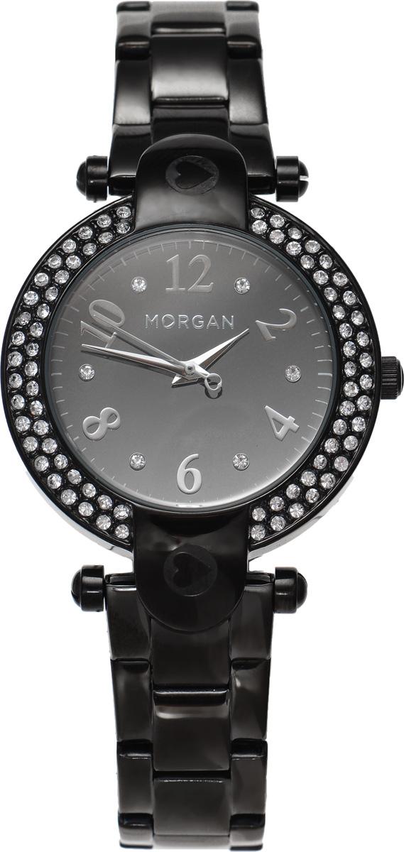 Часы наручные женские Morgan, цвет: черный. M1156BMBM8434-58AEЭлегантные часы Morgan выполнены из стали с IP-покрытием, инкрустированы сияющими чешскими кристаллами и оформлены символикой бренда. Лаконичный корпус с зеркальным циферблатом надежно защищен устойчивым к царапинам минеральным стеклом, а также имеет степень влагозащиты 3 Bar. Часы оснащены кварцевым механизмом, дополнены изящным браслетом, который застегивается на замок-клипсу.Изделие поставляется в фирменной упаковке.Часы Morgan подчеркнут изящество женской руки и отменное чувство стиля у их обладательницы.