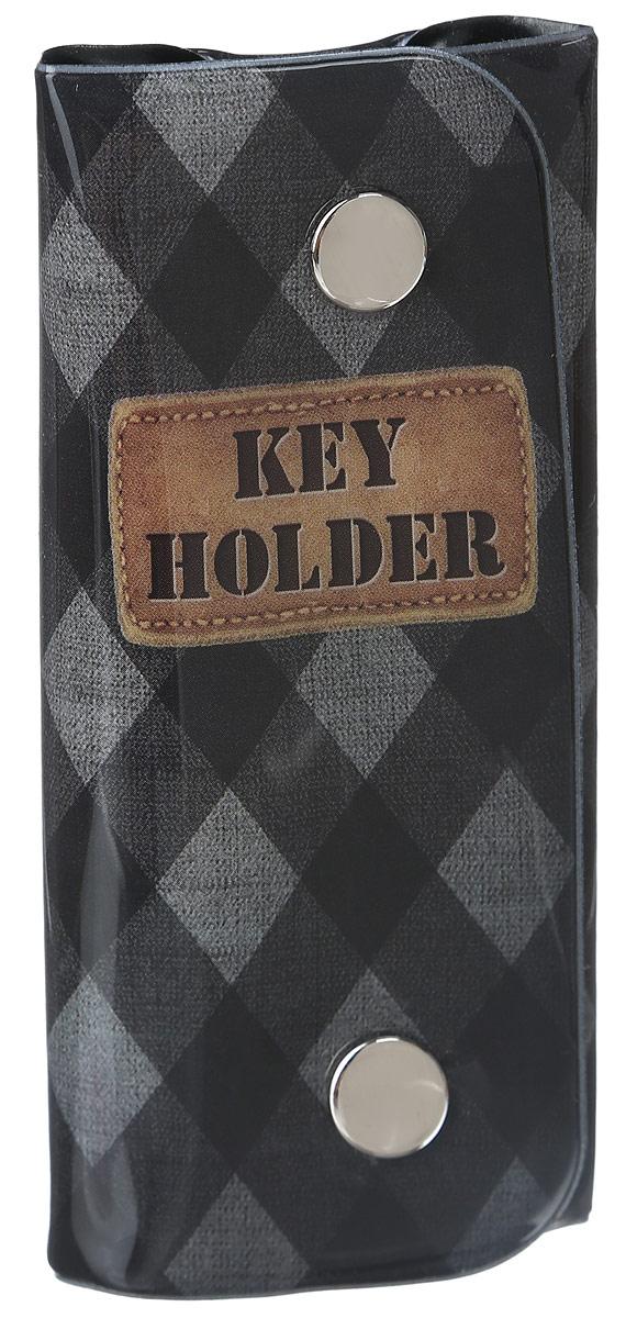 Ключница Magic Home Ромбики, цвет: черный, серый. 4104639864|Серьги с подвескамиСтильная ключница Magic Home Ромбики изготовлена из ПВХ и имеет одно отделение, закрывающееся при помощи клапана на две кнопки. Внутри имеется одно кольцо для хранения ключей. Ключница оформлена оригинальным принтом в виде ромбов и надписи Key Holder.Этот аксессуар станет замечательным подарком человеку, ценящему качественные и практичные вещи.