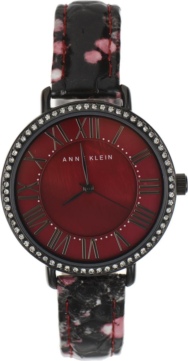 Часы наручные женские Anne Klein Ring, цвет: красный. 1617BM8434-58AEЭлегантные женские часы Anne Klein Ring выполнены из металлического сплава, оформлены чешскими кристаллами и символикой бренда. Циферблат украшен вставкой из натурального перламутра. Лаконичный корпус надежно защищен устойчивым к царапинам минеральным стеклом, а также имеет степень влагозащиты 3 Bar. Часы оснащены кварцевым механизмом, дополнены изящным ремешком из натуральной кожи с декоративным тиснением под кожу рептилии. Ремешок застегивается на практичную пряжку.Часы поставляются в фирменной упаковке.Часы Anne Klein Ring подчеркнут изящество женской руки и отменное чувство стиля у их обладательницы.