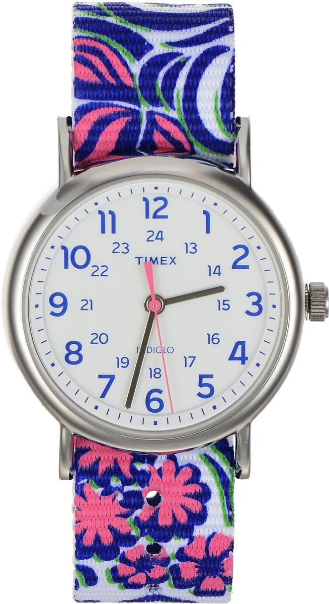 Часы наручные женские Timex Weekender, цвет: фиолетовый, белый. TW2P90200BM8434-58AEСтильные часы Timex Weekender - это модный и практичный аксессуар, который не только выгодно дополнит ваш наряд, но и будет незаменим для каждой современной девушки, ценящей свое время. Корпус с минеральным стеклом выполнен из латуни и оснащен задней крышкой из нержавеющей стали. Циферблат оснащен запатентованной электролюминесцентной подсветкой Indiglo и оформлен символикой бренда.Корпус изделия имеет степень влагозащиты 3 Bar, оснащен кварцевым механизмом и дополнен устойчивым к царапинам минеральным стеклом. Двусторонний ремешок cо стильным цветочным принтом выполнен из нейлона и дополнен пряжкой, которая позволяет с легкостью снимать и надевать изделие.Часы поставляются в фирменной упаковке.Часы Timex подчеркнут изящество ваших рук, а также ваш неповторимый стиль.