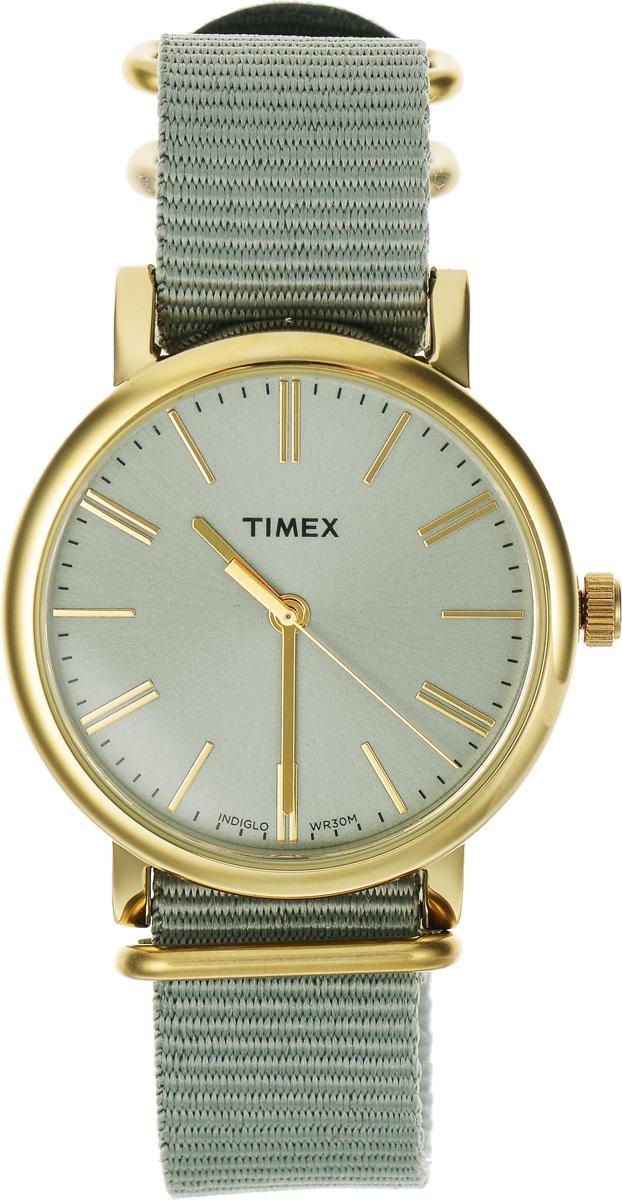 Часы наручные женские Timex Originals, цвет: золотой, оливковый. TW2P88500BM8434-58AEСтильные часы Timex Originals выполнены из нержавеющей стали и минерального стекла. Циферблат оснащен запатентованной электролюминесцентной подсветкой INDIGLO и оформлен символикой бренда.Корпус изделия имеет степень влагозащиты 3 Bar, оснащен кварцевым механизмом и дополнен устойчивым к царапинам минеральным стеклом. Ремешок современного дизайна выполнен из нейлона и оснащен пряжкой, которая позволит с легкостью снимать и надевать изделие.Часы поставляются в фирменной упаковке.Часы Timex Originals подчеркнут изящество женской руки и отменное чувство стиля у их обладательницы.