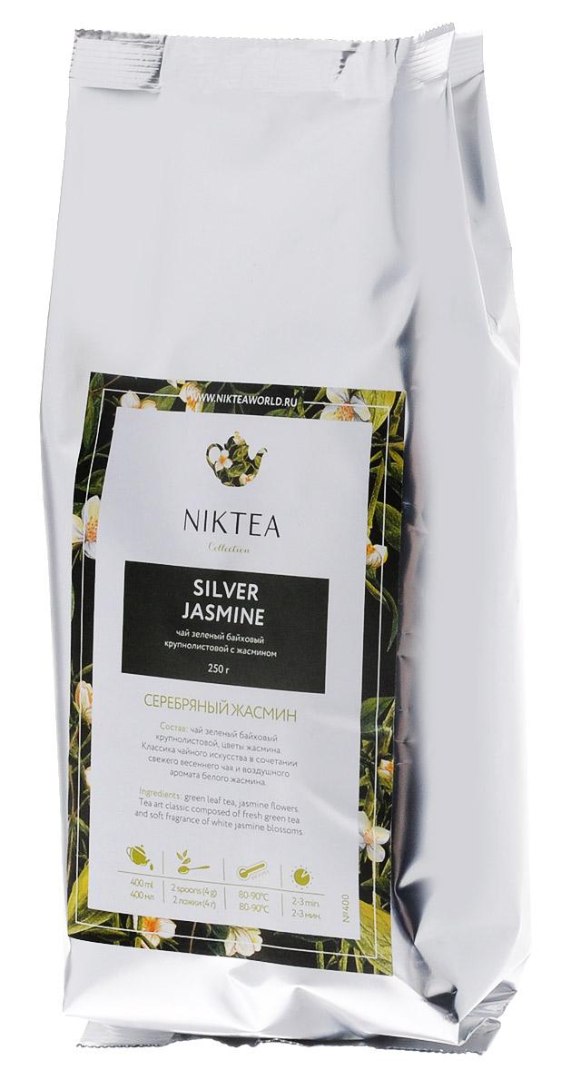 Niktea Silver Jasmine зеленый листовой чай, 250 гTALTHB-DP0017Зеленый листовой чай Niktea Silver Jasmine - это классика чайного искусства в сочетании свежего весеннего чая и воздушного аромата белого жасмина.NikTea следует правилу качество чая - это отражение качества жизни и гарантирует:Тщательно подобранные рецептуры в коллекции топовых позиций-бестселлеров.Контролируемое производство и сертификацию по международным стандартам.Закупку сырья у надежных поставщиков в главных чаеводческих районах, а также в основных центрах тимэйкерской традиции - Германии и Голландии.Постоянство качества по строго утвержденным стандартам.NikTea - это два вида фасовки - линейки листового и пакетированного чая в удобной технологичной и информативной упаковке. Чай обладает многофункциональным вкусоароматическим профилем и подходит для любого типа кухни, при этом постоянно осуществляет оптимизацию базовой коллекции в соответствии с новыми тенденциями чайного рынка.Листовая коллекция NikTea представлена в герметичной фольгированной упаковке, которая эффективно предохраняет чай от воздействия света, влаги и посторонних запахов, обеспечивая длительное хранение. Каждая упаковка снабжена этикеткой с подробным описанием чая, его состава, а также способа заваривания.