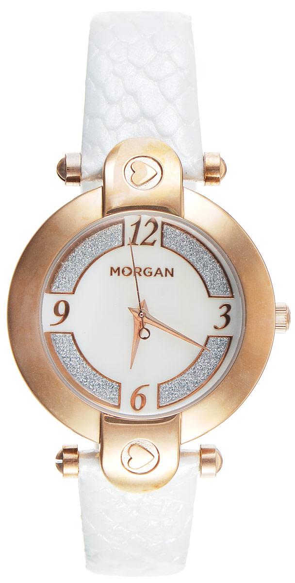 Часы наручные женские Morgan, цвет: золотой, белый. M1134WRGBRBM8434-58AEЭлегантные часы Morgan выполнены из нержавеющей стали и минерального стекла. Циферблат оформлен блестками и символикой бренда.Корпус изделия имеет степень влагозащиты 3 Bar, оснащен кварцевым механизмом и дополнен устойчивым к царапинам минеральным стеклом. Ремешок современного дизайна выполнен из натуральной кожи с декоративным тиснением под кожу рептилии и оснащен пряжкой, которая позволит с легкостью снимать и надевать изделие.Часы поставляются в фирменной упаковке.Часы Morgan подчеркнут изящество женской руки и отменное чувство стиля у их обладательницы.