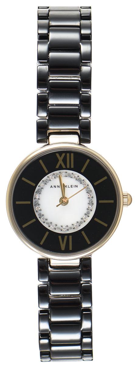 Часы наручные женские Anne Klein Ceramics, цвет: золотой, черный. 2178 BKGBBM8241-01EEЭлегантные женские часы Anne Klein Ceramics выполнены из металлического сплава, оформлены кристаллами Swarovski и символикой бренда. Циферблат часов украшен перламутровой вставкой. Лаконичный корпус надежно защищен устойчивым к царапинам минеральным стеклом. Часы оснащены кварцевым механизмом, дополнены изящным браслетом со складным замком. В конструкции застежки предусмотрено дополнительное звено, благодаря которому возможно регулировать длину изделия.Часы поставляются в фирменной упаковке.Часы Anne Klein Ceramics подчеркнут изящество женской руки и отменное чувство стиля у их обладательницы.