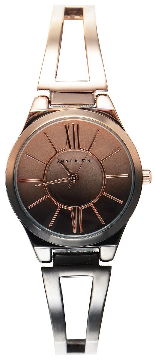 Часы наручные женские Anne Klein Ring, цвет: черный, золотистый. 2152 OMRGBM8434-58AEСтильные женские часы Anne Klein Ring с эффектом градиента выполнены из металлического сплава, оформлены символикой бренда. Лаконичный корпус надежно защищен устойчивым к царапинам минеральным стеклом, а также имеет степень влагозащиты 3 Bar. Часы оснащены кварцевым механизмом, дополнены изящным браслетом со складным замком. В конструкции застежки предусмотрено дополнительное звено, благодаря которому возможно регулировать длину изделия.Часы поставляются в фирменной упаковке.Часы Anne Klein Ring подчеркнут изящество женской руки и отменное чувство стиля у их обладательницы.