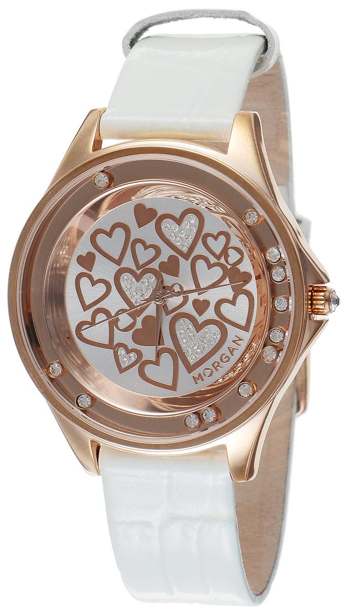 Часы наручные женские Morgan, цвет: золотой, белый. M1136WRGBRBM8434-58AEЭлегантные часы Morgan выполнены из стали с IP-покрытием, оформлены символикой бренда и инкрустированы чешскими кристаллами. Лаконичный корпус часов дополнен плавающими по окружности кристаллами, а также надежно защищен устойчивым к царапинам минеральным стеклом.Часы оснащены кварцевым механизмом, дополнены кожаным ремешком с лаковым покрытием и декоративным тиснением под кожу рептилии. Ремешок застегивается на практичную пряжку.Изделие поставляется в фирменной упаковке.Часы Morgan подчеркнут изящество женской руки и отменное чувство стиля у их обладательницы.