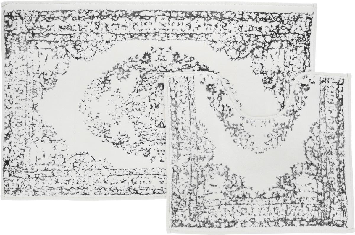 Набор ковриков для ванной Arya Venus, цвет: серый, молочный, 2 штPARIS 75015-8C ANTIQUEНеобыкновенные коврики для ванной Arya Venus обладают эффектным дизайном, мягким и легким в уходе ворсом, нежным естественным оттенком, а также насыщенным цветом.Набор состоит из двух ковриков, выполненных из хлопка и вискозы. Верхняя часть из ворса 4 мм. Коврики украшены рисунком, который придаст еще большей элегантности дизайну ванной комнаты. Особенности изделий:Края ковриков обработаны. Коврики не требовательны в уходе, если они чрезмерно не пачкаются и не загрязняются. В зависимости от интенсивности использования достаточно раз в месяц или в три месяца привести их в порядок. Коврики легко сворачиваются или складываются и помещаются в емкость для стирки. Данные коврики легко выдержат машинную стирку на бережном цикле при 30°С. Хорошо впитывают влагу, быстро сохнут.Коврик - это необходимый предмет, без которого невозможен комфорт и уют в ванной комнате. Размер ковриков: 60 х 100 см, 50 х 60 см.