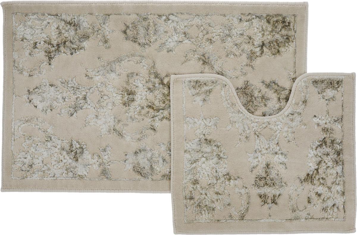 Набор ковриков для ванной Arya Osmanli, цвет: темно-бежевый, белый, 2 шт15042_прозрачныйНеобыкновенные коврики для ванной Arya Osmanli обладают эффектным дизайном, мягким и легким в уходе ворсом, нежным естественным оттенком, а также насыщенным цветом.Набор состоит из двух ковриков, выполненных из хлопка и вискозы. Верхняя часть из ворса 4 мм. Коврики украшены рисунком, который придаст еще большей элегантности дизайну ванной комнаты. Особенности изделий:Края ковриков обработаны. Коврики не требовательны в уходе, если они чрезмерно не пачкаются и не загрязняются. В зависимости от интенсивности использования достаточно раз в месяц или в три месяца привести их в порядок. Коврики легко сворачиваются или складываются и помещаются в емкость для стирки. Данные коврики легко выдержат машинную стирку на бережном цикле при 30°С. Хорошо впитывают влагу, быстро сохнут.Коврик - это необходимый предмет, без которого невозможен комфорт и уют в ванной комнате. Размер ковриков: 60 х 100 см, 50 х 60 см.