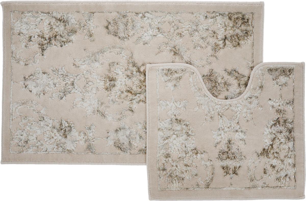 Набор ковриков для ванной Arya Osmanli, цвет: бежевый, белый, 2 шт55767 коричневыйНеобыкновенные коврики для ванной Arya Osmanli обладают эффектным дизайном, мягким и легким в уходе ворсом, нежным естественным оттенком, а также насыщенным цветом.Набор состоит из двух ковриков, выполненных из хлопка и вискозы. Верхняя часть из ворса 4 мм. Коврики украшены рисунком, который придаст еще большей элегантности дизайну ванной комнаты. Особенности изделий:Края ковриков обработаны. Коврики не требовательны в уходе, если они чрезмерно не пачкаются и не загрязняются. В зависимости от интенсивности использования достаточно раз в месяц или в три месяца привести их в порядок. Коврики легко сворачиваются или складываются и помещаются в емкость для стирки. Данные коврики легко выдержат машинную стирку на бережном цикле при 30°С. Хорошо впитывают влагу, быстро сохнут.Коврик - это необходимый предмет, без которого невозможен комфорт и уют в ванной комнате. Размер ковриков: 60 х 100 см, 50 х 60 см.