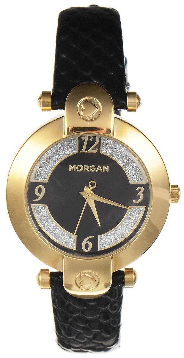 Часы наручные женские Morgan, цвет: золотой, черный. M1134BGBRBM8434-58AEЭлегантные часы Morgan выполнены из нержавеющей стали и минерального стекла. Циферблат оформлен блестками и символикой бренда.Корпус изделия имеет степень влагозащиты 3 Bar, оснащен кварцевым механизмом и дополнен устойчивым к царапинам минеральным стеклом. Ремешок современного дизайна выполнен из натуральной кожи с декоративным тиснением под кожу рептилии и оснащен пряжкой, которая позволит с легкостью снимать и надевать изделие.Часы поставляются в фирменной упаковке.Часы Morgan подчеркнут изящество женской руки и отменное чувство стиля у их обладательницы.