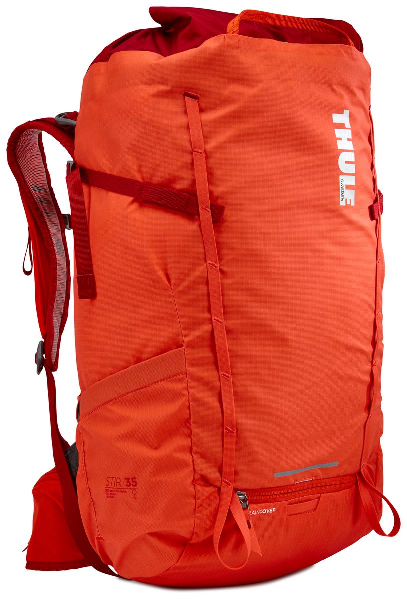 Рюкзак женский Thule Stir 35L, цвет: оранжевый, 35 л211403Женский рюкзак для пеших путешествий Thule Stir с объемом 35 л. Благодаря простому и элегантному дизайну в сочетании с регулировкой рюкзака по спине, множеством легкодоступных карманов и дождевым чехлом этот рюкзак идеально подходит для более долгих дневных походов. Легкодоступная крышка с защитным откидным клапаном. Система StormGuard - это комбинация частичного дождевого чехла с водонепроницаемым нижним слоем для создания полностью защищенного от непогоды рюкзака. Конструкция StormGuard обеспечивает удобный доступ к снаряжению, препятствует проникновению влаги и более надежна, чем обычный дождевой чехол. Регулировка по спине в пределах 10 см обеспечивает идеальную посадку. Съемные поясной и нагрудный ремни для городского использования. Боковая молния для удобного доступа к снаряжению. Эластичный карман на плечевом ремне для хранения телефона и других небольших предметов. Точка крепления петли для фонаря и светоотражающий материал. Передний карман Shove-it Pocket для быстрого доступа. Две петли-крепления для треккинговых палок или ледорубов.