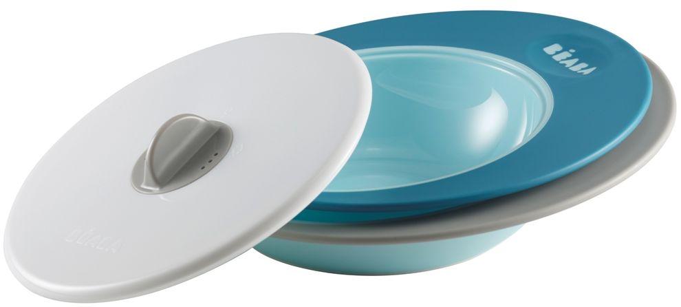 Beaba Набор тарелок для кормления Ellipse цвет голубой синий115510Специальная форма тарелок Ellipse - сохраняет еду ребенка теплой длительное время. Набор тарелок: две тарелки и крышка.Объем тарелок:тарелка - 210 мл,глубока тарелка – 300 млИспользование с 6 месяцев.Набор тарелок имеет два положения крышки. Тарелки имеют высокие и широкие края для удобного перемешивания, их выгнутое дно предназначено для естественного распределения пищи по тарелке и удобного захвата ребенком. Тарелки можно использовать в микроволновой печи, они прекрасно сохраняют тепло.Имеют нескользящее основание.