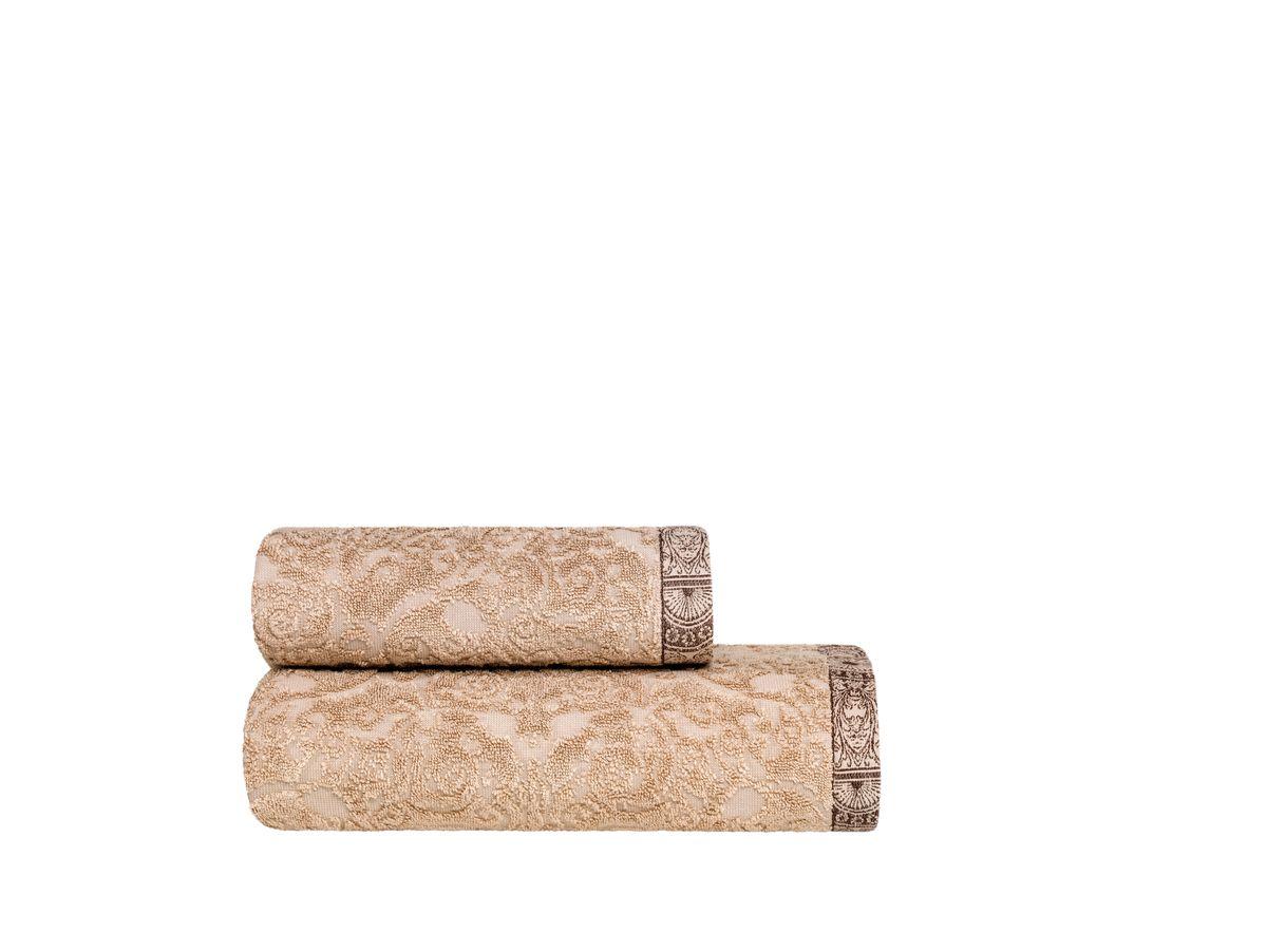 Полотенце Togas Генрих, цвет: бежевый, 70 х 140 см1004900000360Полотенце Togas Генрих невероятно гармонично сочетает в себе лучшие качества современного махрового текстиля. Безупречные по качеству, экологичное полотенце из 50% хлопка и 50% модала идеально заботится о вашей коже, особенно после душа, когда вы расслаблены и особо уязвимы. Деликатный дизайн полотенца Togas «Генрих» - воплощение изысканной простоты, где на первый план выходит качество материала. Невероятно мягкое волокно модал, превосходящее по своим свойствам даже хлопок, позволяет улучшить впитывающие качества полотенца и делает его удивительно мягким. Модал - это 100% натуральное, экологически чистое целлюлозное волокно. Оно производится без применения каких-либо химических примесей, поэтому абсолютно гипоаллергенно.Полотенце Togas Генрих, обладающее идеальными качествами, будет поднимать вам настроение.