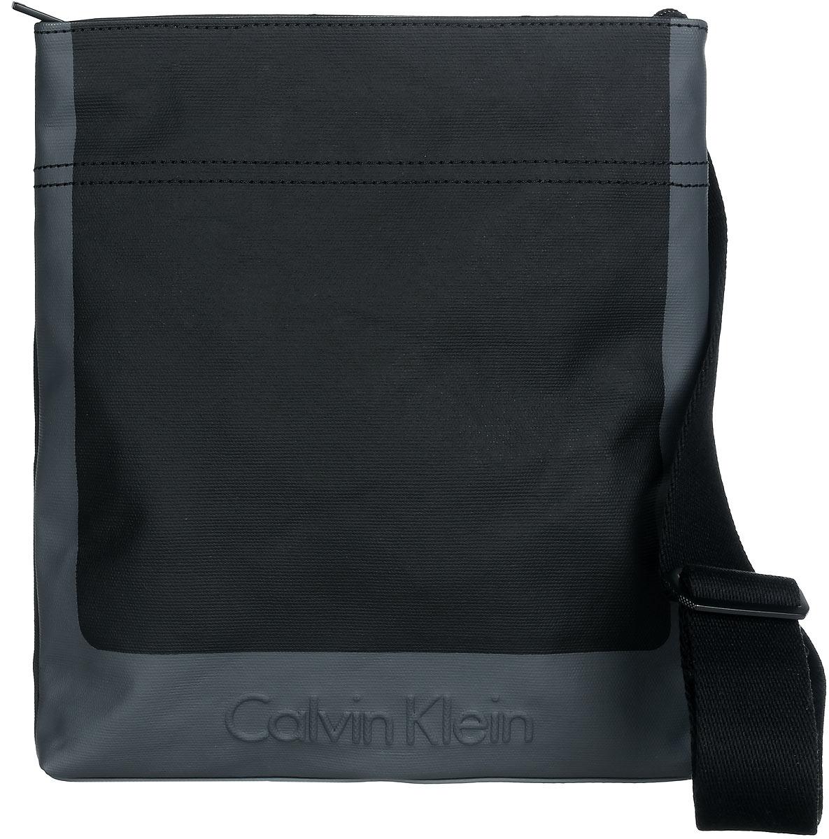 Сумка мужская Calvin Klein Jeans, цвет: черный, серый. K50K502156_0010J3IJ302251_4880Стильная сумка Calvin Klein выполнена из полиуретана и хлопка, оформлена тиснением в виде логотипа бренда.Изделие содержит одно отделение, которое закрывается на застежку-молнию. Внутри сумки размещены два накладных кармашка для мелочей и врезной карман на застежке-молнии. На задней стороне расположен открытый накладной кармашек. Сумка оснащена плечевым ремнем регулируемой длины. В комплекте с изделием поставляется чехол для хранения.Модная сумка идеально подчеркнет ваш неповторимый стиль.