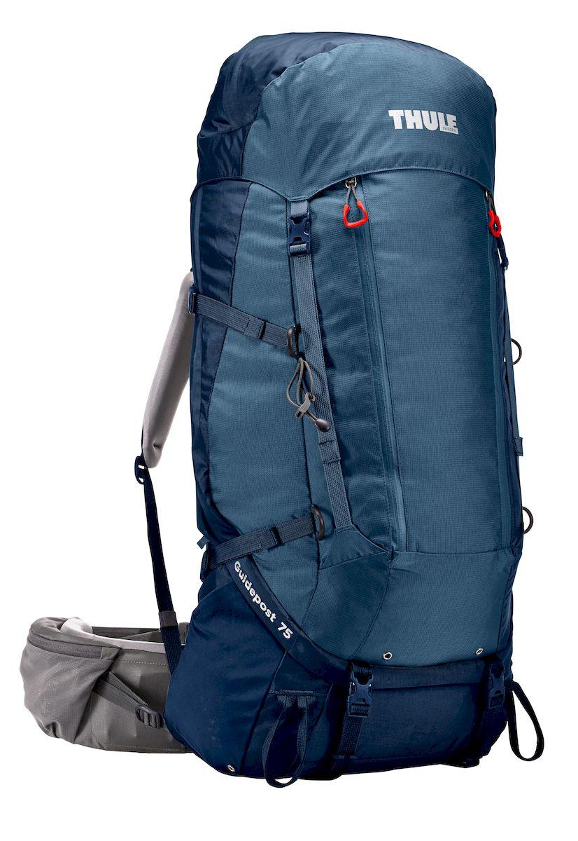 Рюкзак треккинговый мужской Thule Guidepost, цвет: темно-синий, 75 лKOC-H19-LEDРюкзак треккинговый мужской Thule Guidepost с объемом 75 л идеально подходит для недельных походов. Рюкзак отличается настраиваемой системой крепления TransHub, обеспечивающей идеальную посадку, поворачивающимся набедренным ремнем, который позволяет рюкзаку повторять ваши движения, и крышкой, способной трансформироваться в дополнительный рюкзак, который поможет вам покорить любую вершину.Легкая регулировка ремней для торса на 15 см обеспечивает идеальную посадку, а наплечные ремни QuickFit позволяют выбрать из один из трех вариантов длины наплечных ремней.Система крепления Transhub с алюминиевой опорой и проволочным каркасом из пружинной стали позволяют перенести вес рюкзака на бедра, обеспечивая более удобную переноску. Поворачивающийся набедренный ремень позволяет рюкзаку повторять ваши движения, обеспечивая большую естественность передвижения и улучшенный баланс.Съемная крышка трансформируется в просторный рюкзак 24 л, позволяя сочетать два рюкзака в одном. Удобный доступ к содержимому рюкзака благодаря большой J-образной застежке на молнии на боковой панели.Воздухопроницаемая задняя панель обеспечивает поддержку в главных точках соприкосновения, но при этом позволяет воздуху циркулировать и не дает вам потеть. Два больших передних кармана на застежках-молниях предназначены для хранения часто используемых предметов. Удобное хранение трекинговых палок или ледоруба при помощи двух петель-креплений. Два кармана на набедренном ремне с застежками-молниями и эластичные боковые карманы позволяют хранить бутылки, еду и другие мелкие предметы. Конструкция, предназначенная для хранения воды, включает внешний карман для бутылки с водой и обеспечивает удобный доступ к ней (бутылка продается отдельно).
